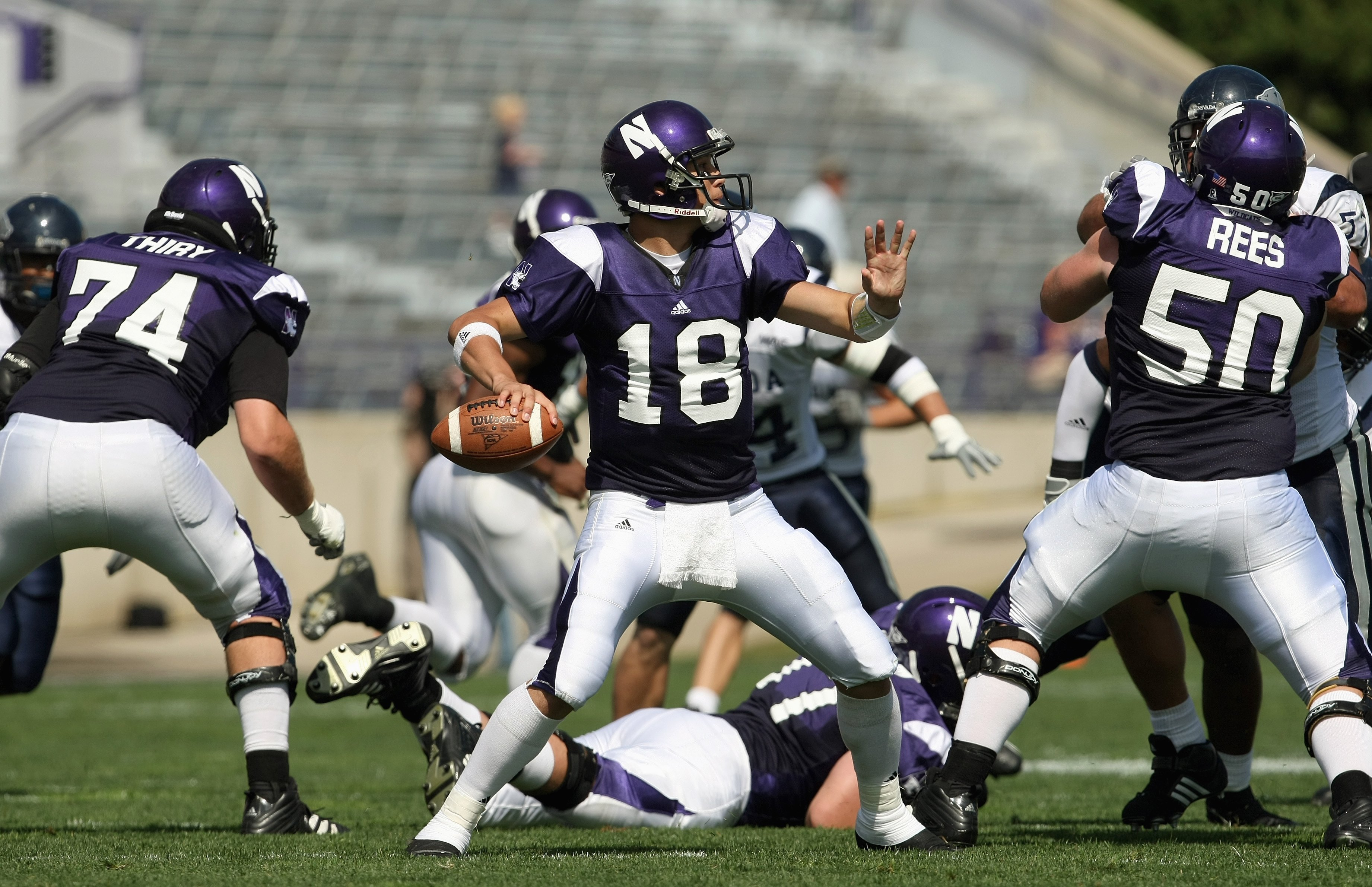 EVANSTON, IL - SEPTEMBER 8: Quarterback C.J. Bacher #18 of the Northwestern Wildcats passes the ball during the game against the Nevada Wolf Pack on September 8, 2007 at Ryan Field at Northwestern University in Evanston, Illinois. (Photo by Jonathan Danie