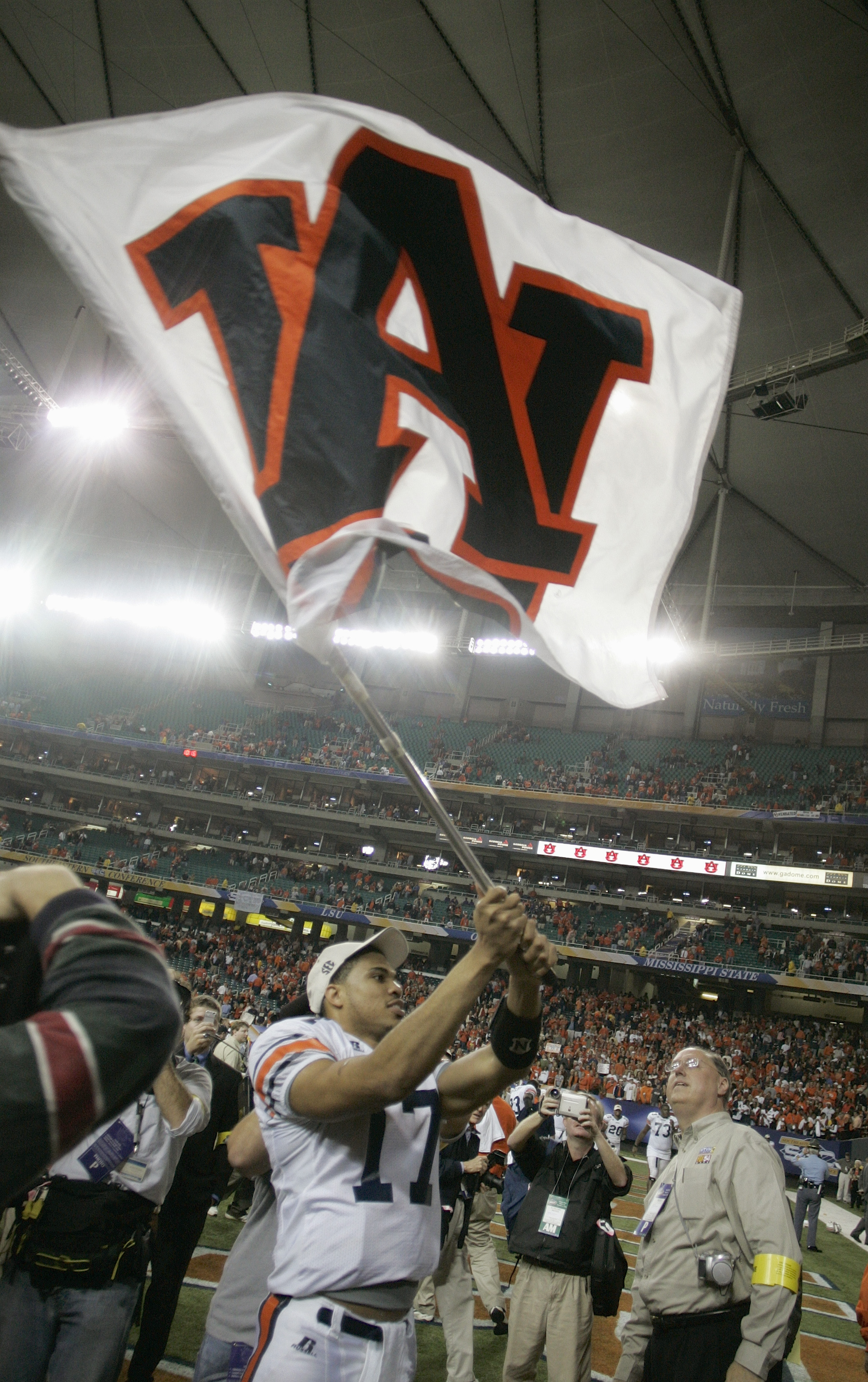 ATLANTA, GA - DECEMBER 4:  Quarterback Jason Campbell #17 of the Auburn Tigers waves his school flag after facing the Tennessee Volunteers in the 2004 SEC Championship Game at the Georgia Dome on December 4, 2004 in Atlanta, Georgia. Auburn defeated Tenne