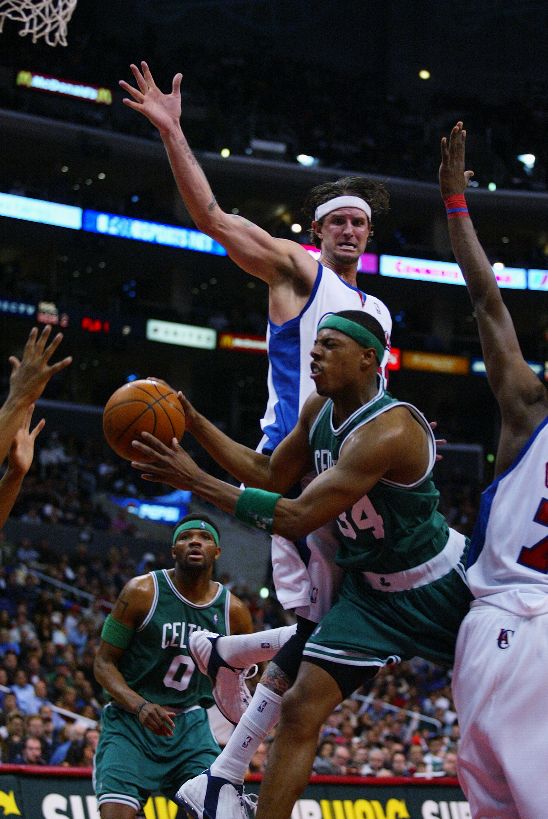 LOS ANGELES - FEBRUARY 15:  Paul Pierce #34 of the Boston Celtics drives to the basket past Cherokee Parks #44 of the Los Angeles Clippers during the NBA game at Staples Center on February 15, 2003 in Los Angeles, California.  The Celtics won 92-84.  NOTE