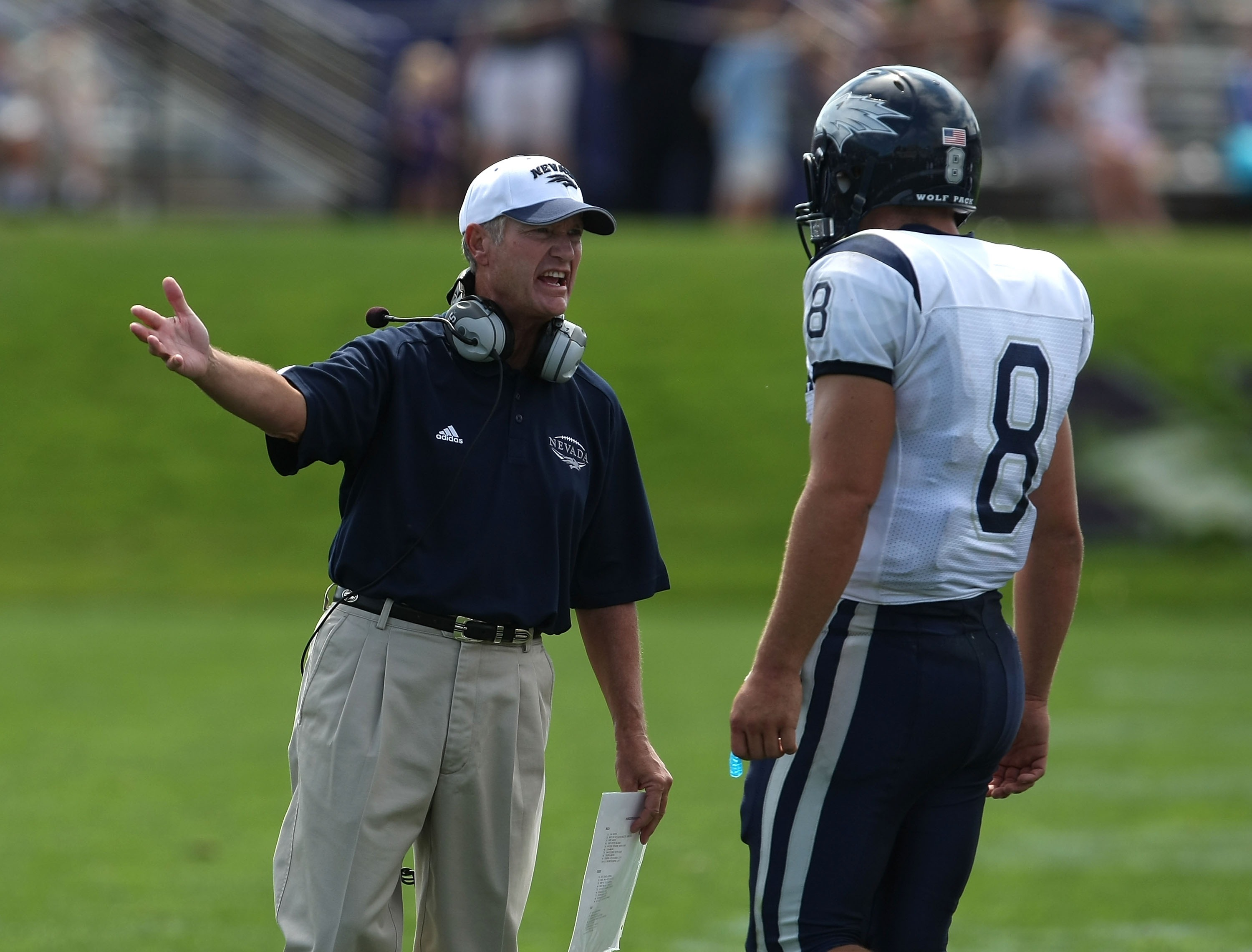 EVANSTON, IL - SEPTEMBER 08: Head coach Chris Ault of the Nevada Wolf Pack has words with quarterback Nick Graziano #8 during a game against the Northwestern Wildcats on September 8, 2007 at Ryan Field at Northwestern University in Evanston, Illinois. (Ph