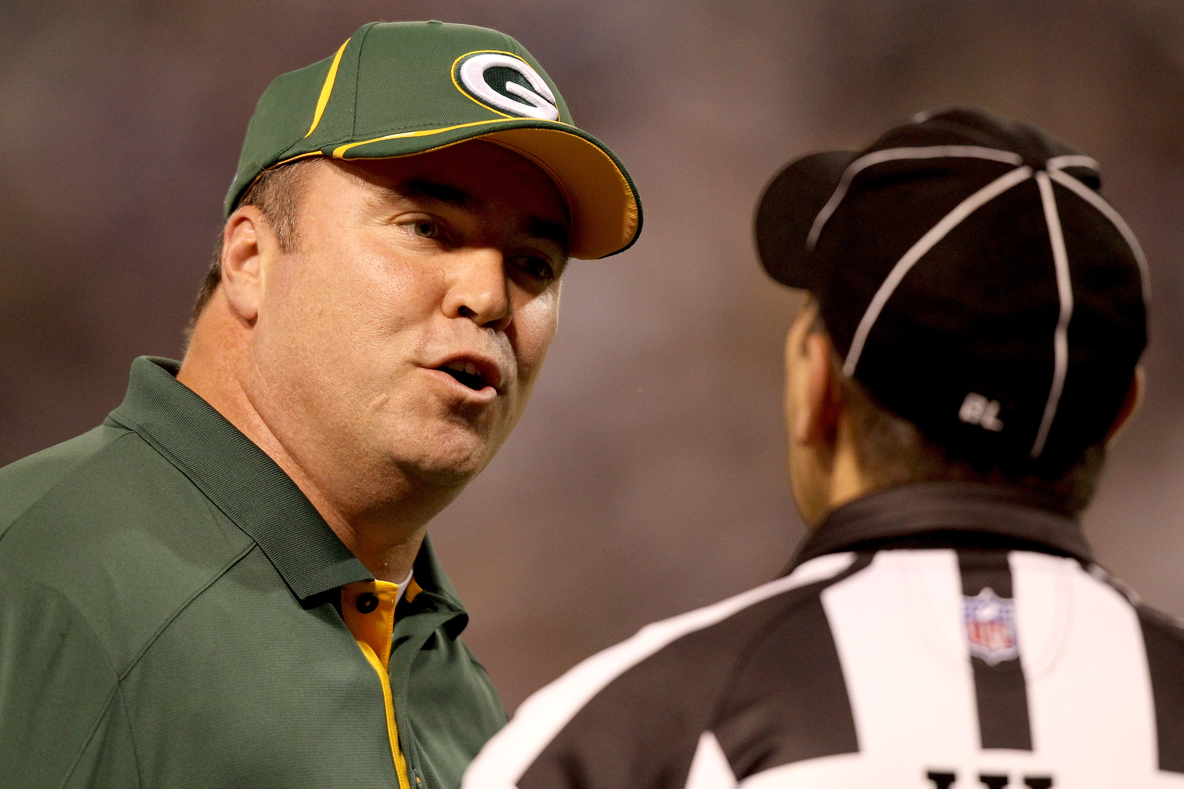 MINNEAPOLIS - NOVEMBER 21:  Head Coach Mike McCarthy of the Green Bay Packers discusses a call with Head Linesman Tony Veteri while playing the Minnesota Vikings at the Hubert H. Humphrey Metrodome on November 21, 2010 in Minneapolis, Minnesota.  (Photo b