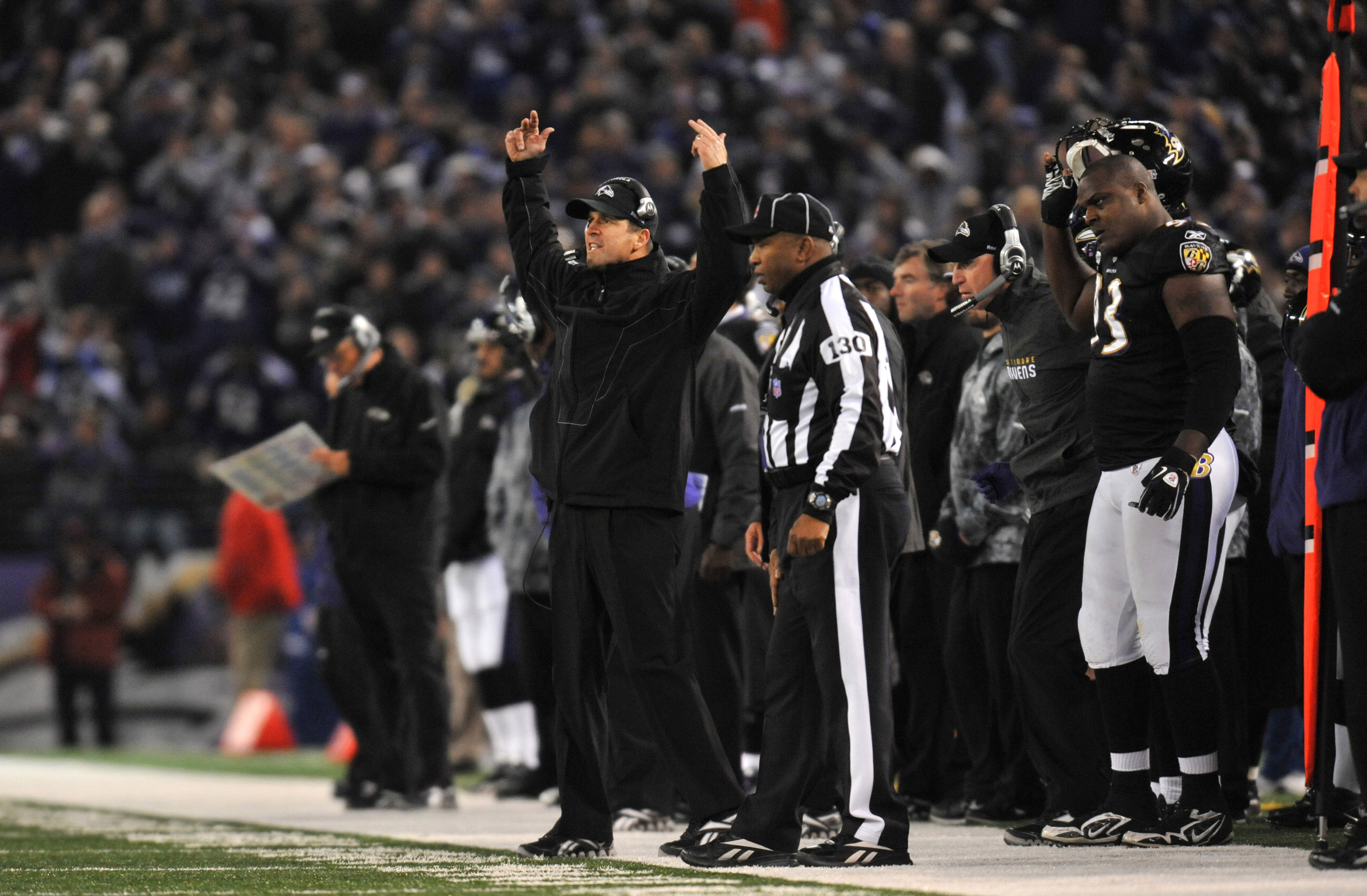 BALTIMORE, MD - NOVEMBER 28:  Head coach John Harbaugh of the Baltimore Ravens cheers on his team during the game against the Tampa Bay Buccaneers at M&T Bank Stadium on November 28, 2010 in Baltimore, Maryland. The Ravens defeated the Buccaneers 17-10. (