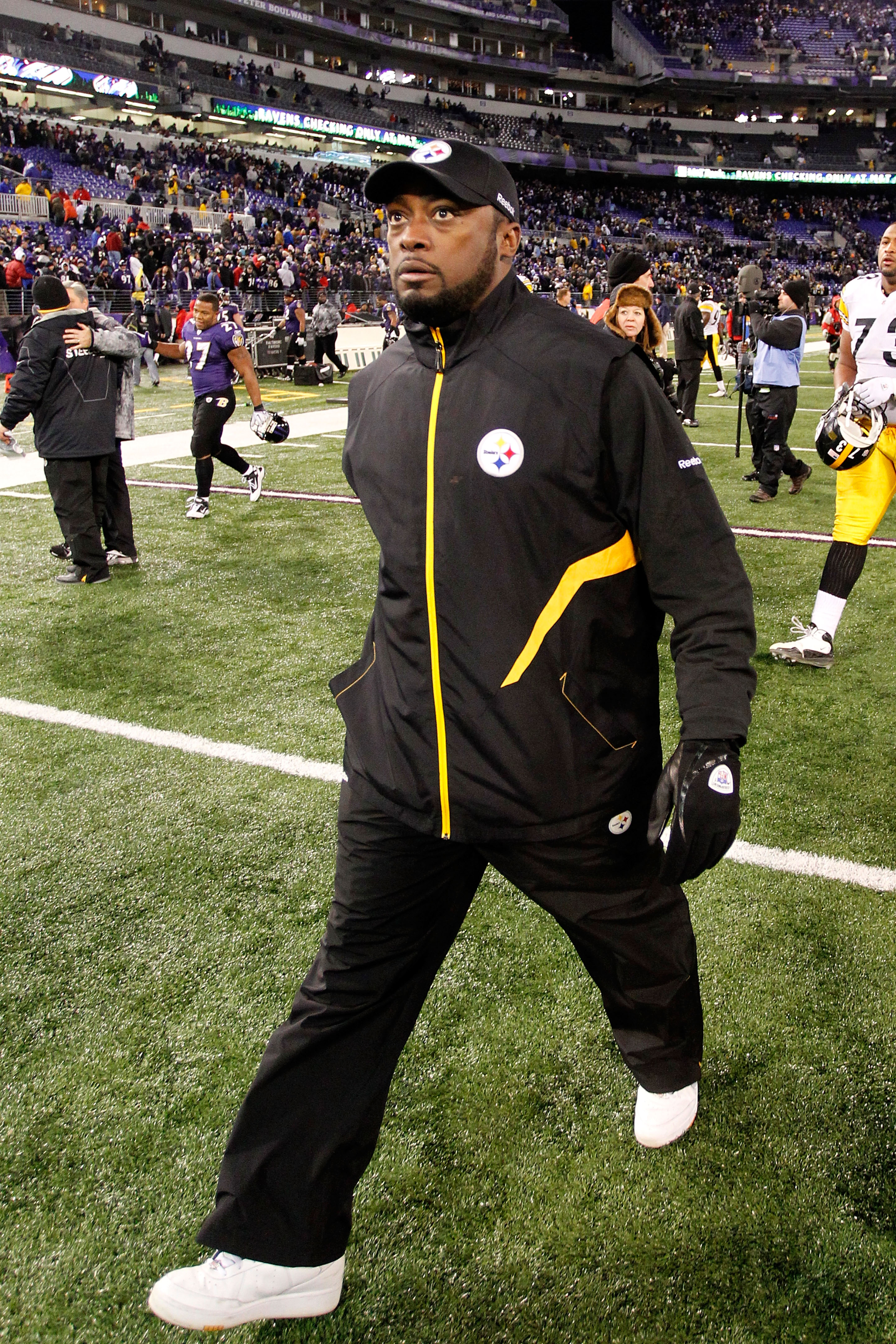 BALTIMORE, MD - DECEMBER 05:  Mike Tomlin head coach of the Pittsburgh Steelers walks off the field after defeating the Baltimore Ravens 13-10 at M&T Bank Stadium on December 5, 2010 in Baltimore, Maryland.  (Photo by Geoff Burke/Getty Images)