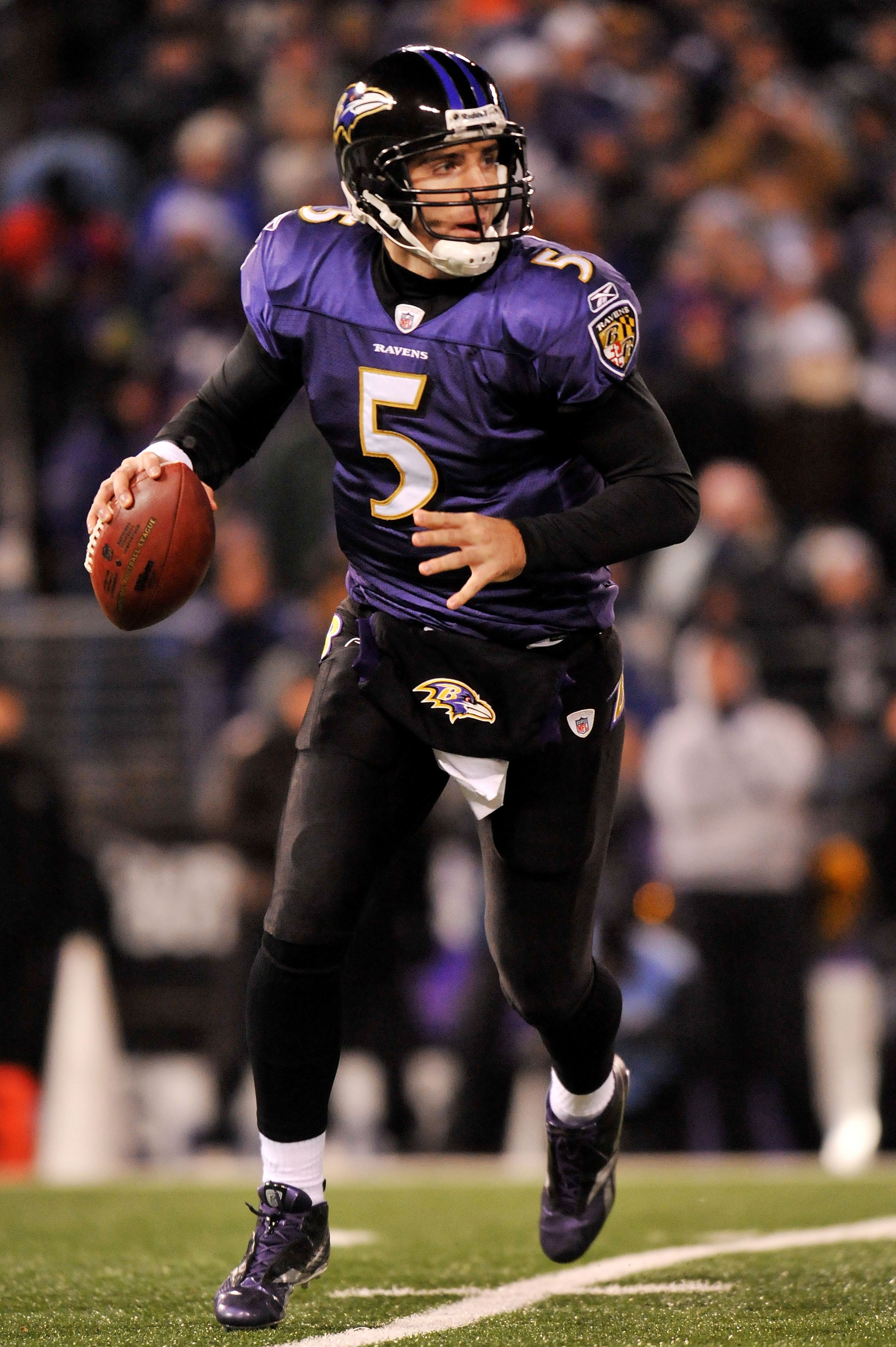 BALTIMORE, MD - DECEMBER 05:  Quarterback Joe Flacco #5 of the Baltimore Ravens looks to pass against the Pittsburgh Steelers during the first half of the game at M&T Bank Stadium on December 5, 2010 in Baltimore, Maryland.  (Photo by Larry French/Getty I