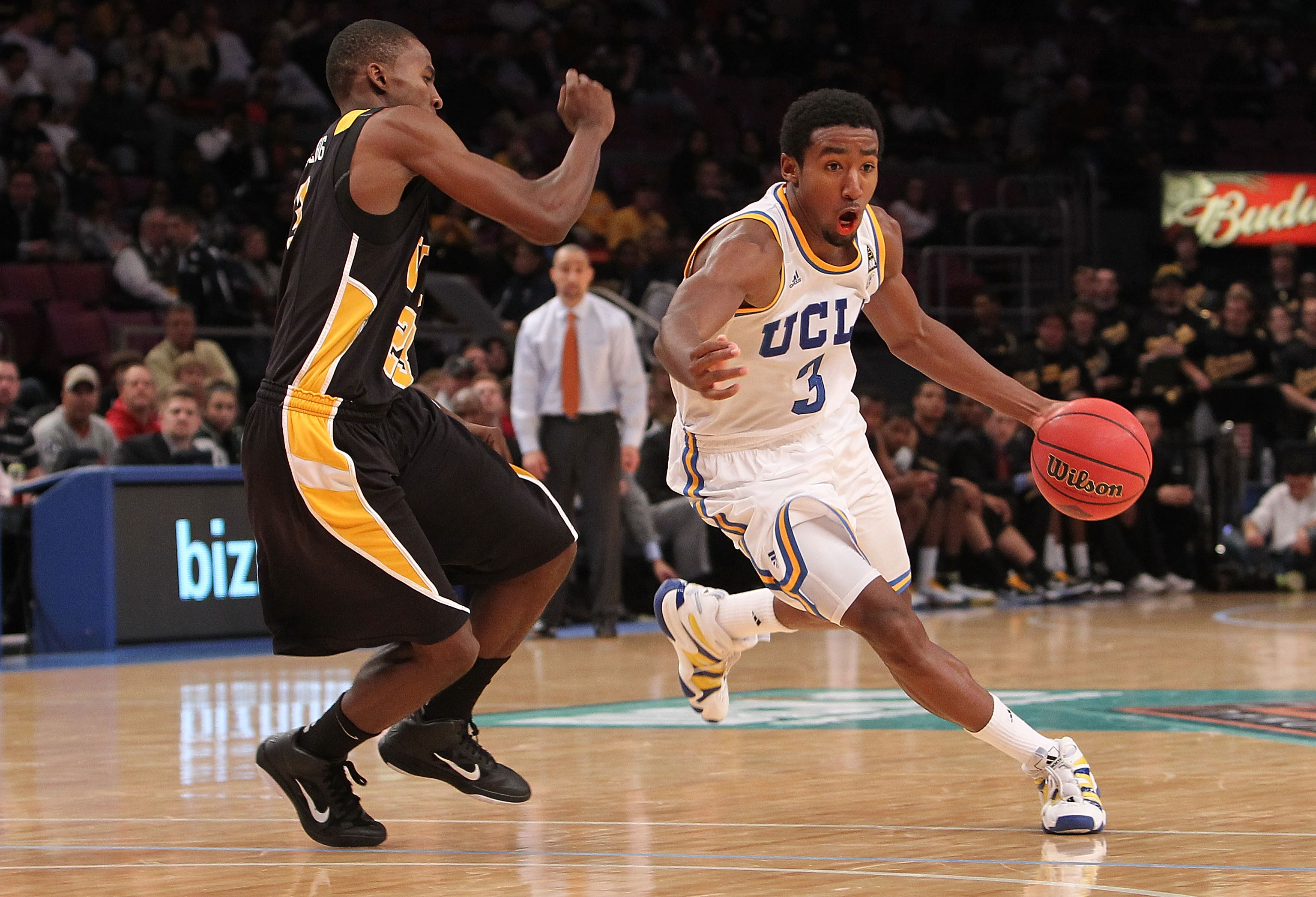 NEW YORK - NOVEMBER 26: Malcolm Lee #3 of the UCLA Bruins dribbles the ball against Rob Brandenberg #23 of the Virginia Commonwealth Rams during their consolation game at Madison Square Garden on November 26, 2010 in New York City.  (Photo by Nick Laham/G