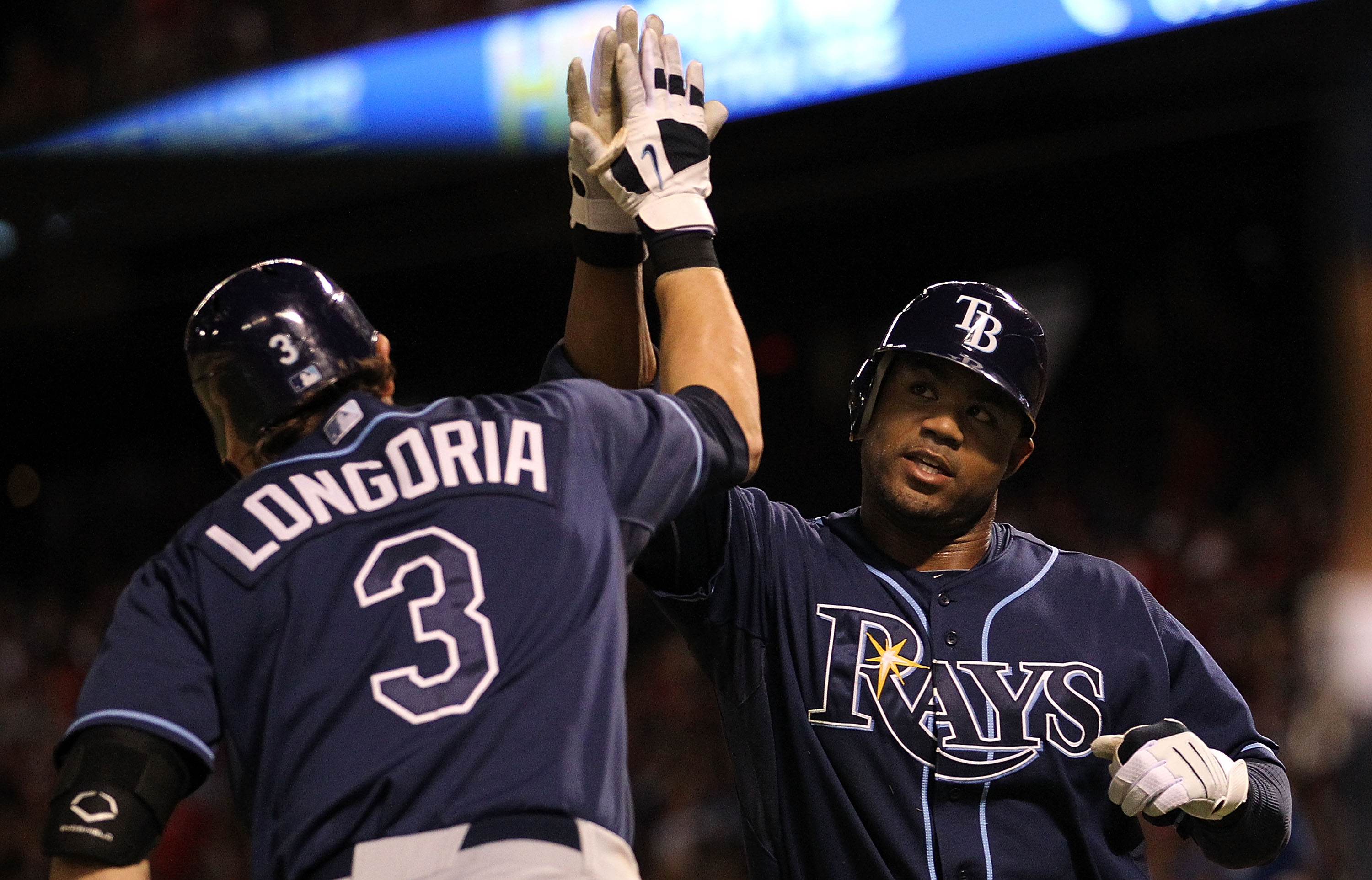 ARLINGTON, TX - OCTOBER 09:  Carl Crawford #13 of the Tampa Bay Rays celebtes a solo homerun with Evan Longoria #3 against the Texas Rangers in the 9th inning during game 3 of the ALDS at Rangers Ballpark in Arlington on October 9, 2010 in Arlington, Texa