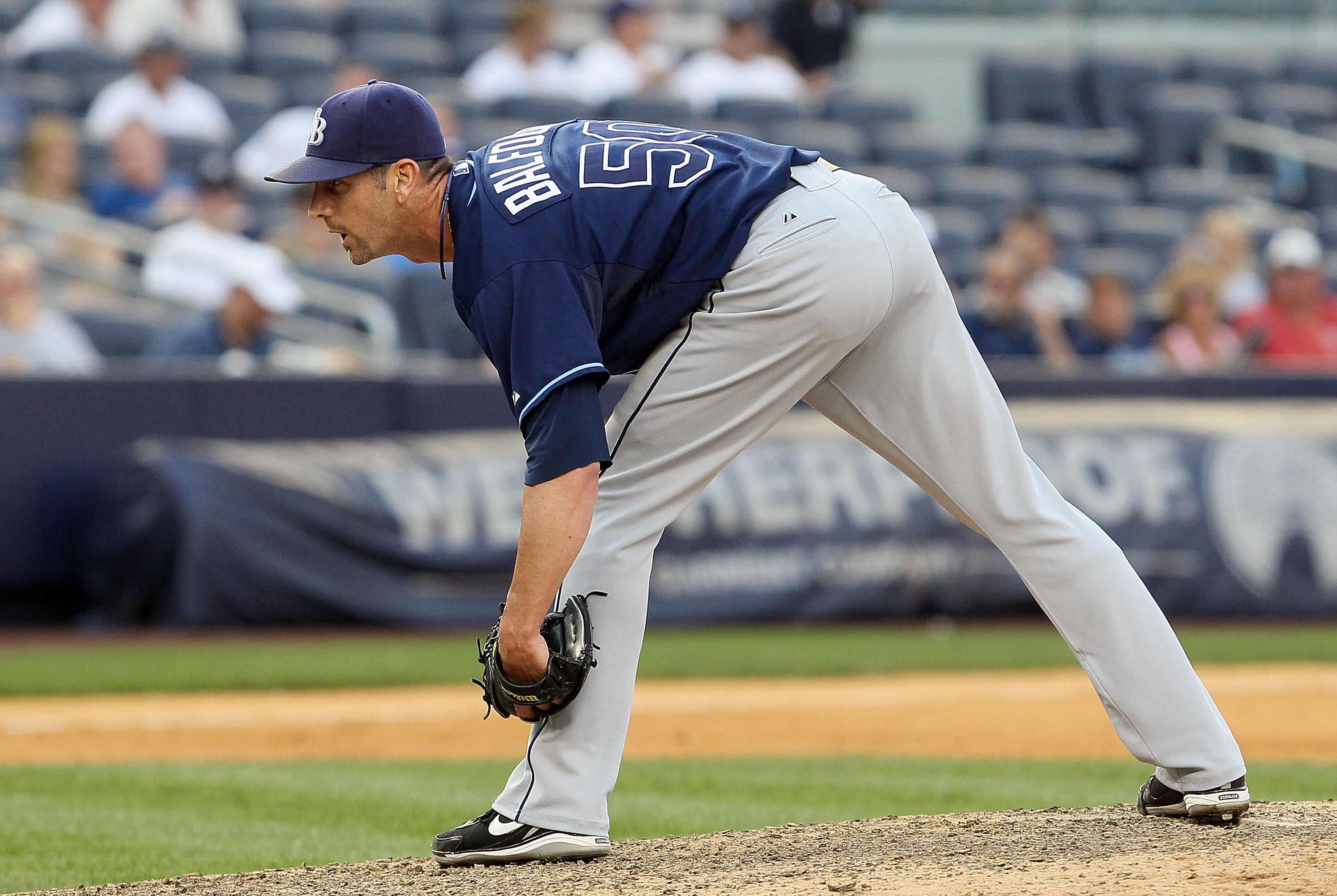 NEW YORK - JULY 17:  Grant Balfour #50 of the Tampa Bay Rays delivers a pitch against the New York Yankees on July 17, 2010 at Yankee Stadium in the Bronx borough of New York City. The Rays defeated the Yankees 10-5.  (Photo by Jim McIsaac/Getty Images)