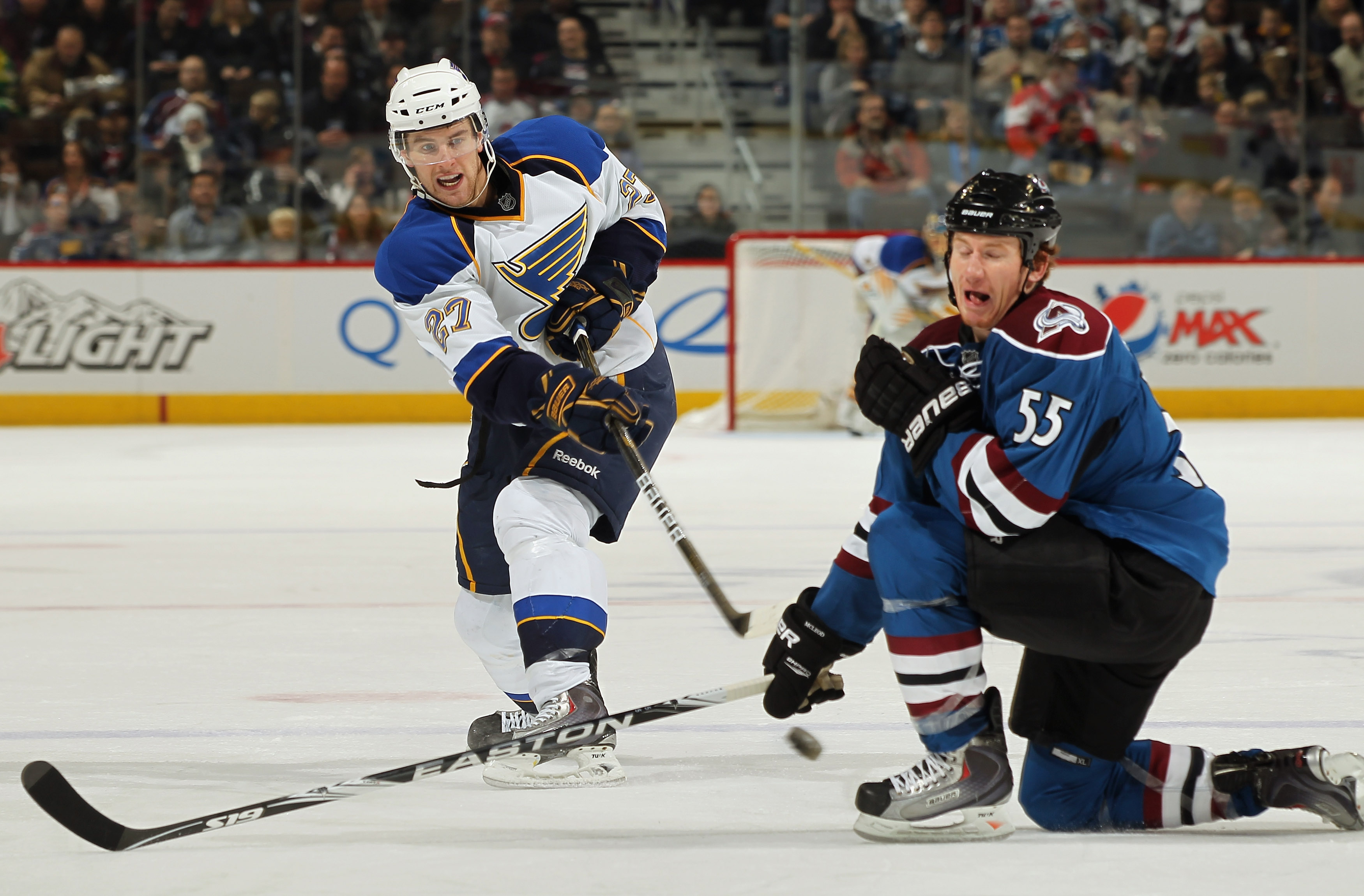 DENVER - NOVEMBER 15:  Alex Pietrangelo #27 of the St. Louis Blues takes a shot as Cody McLeod #55 of the Colorado Avalanche defends at the Pepsi Center on November 15, 2010 in Denver, Colorado. The Avalacnhe defeated the Blues 6-3.  (Photo by Doug Pensin