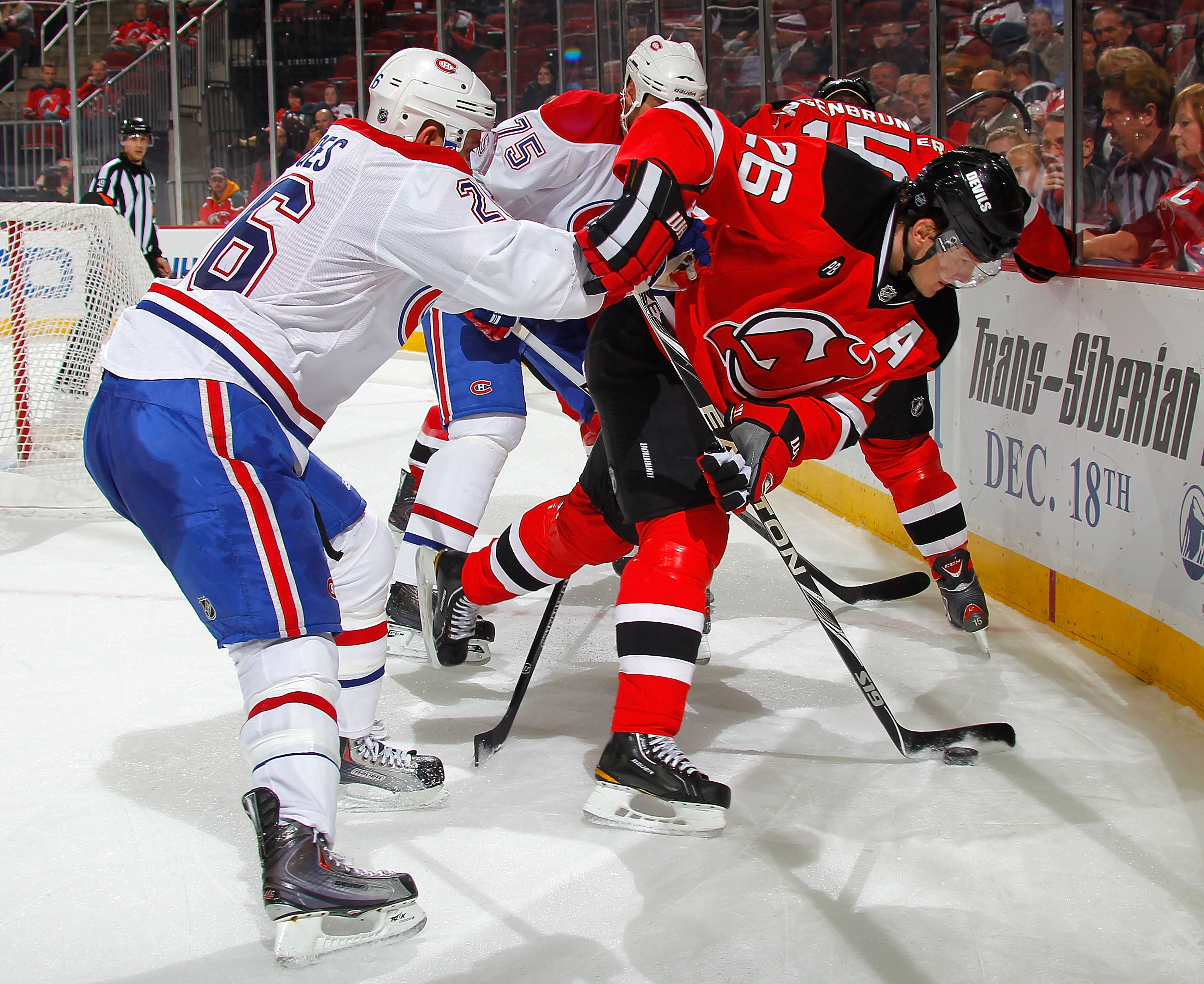NEWARK, NJ - DECEMBER 02:  Josh Gorges #26 of the Montreal Canadiens checks Patrik Elias #26 of the New Jersey Devils during the second period of a hockey game at the Prudential Center on December 2, 2010 in Newark, New Jersey.  (Photo by Paul Bereswill/G
