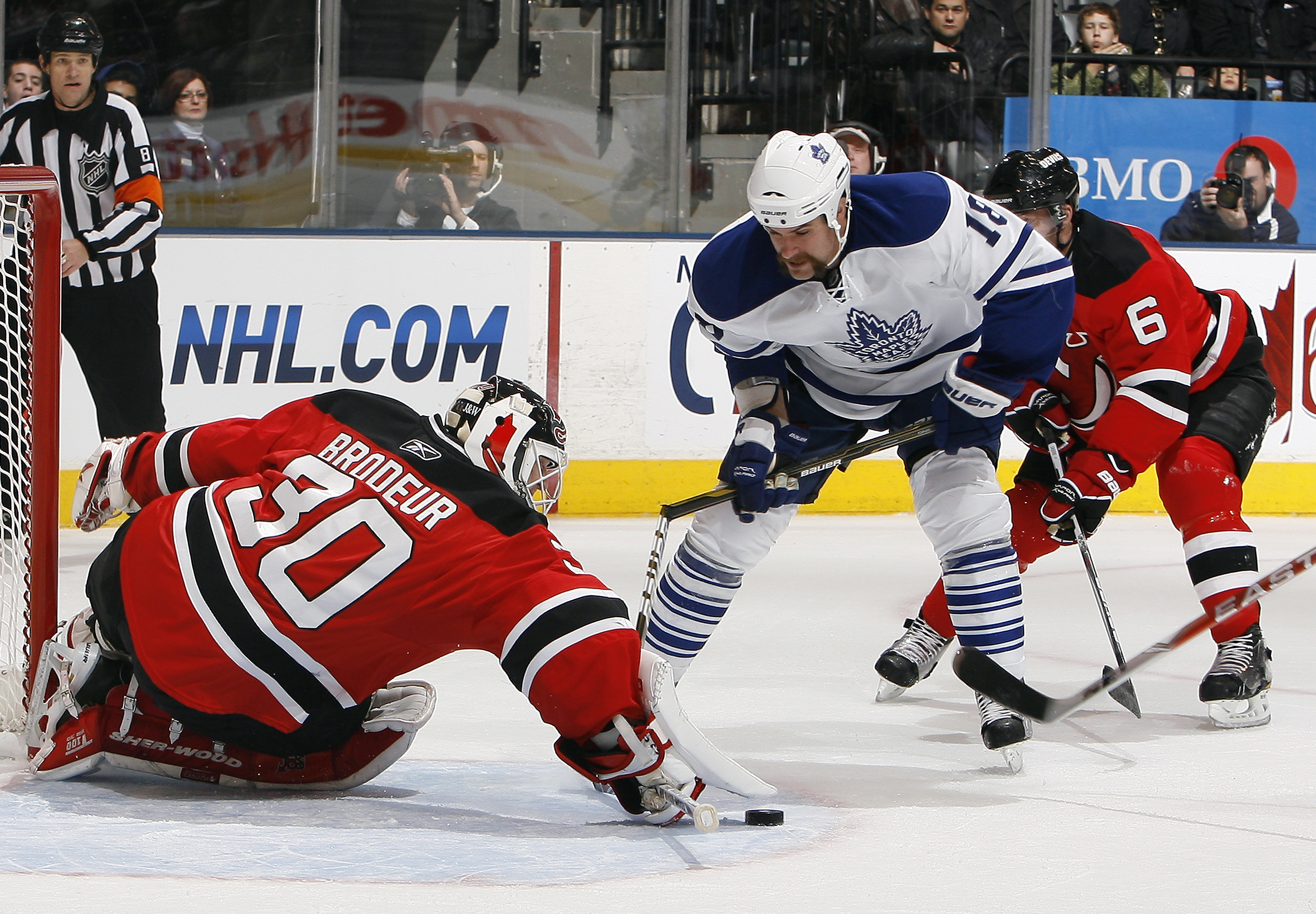 TORONTO - NOVEMBER 18: Mike Brown #18 of the Toronto Maple Leafs breaks his stick while getting around Martin Brodeur #30 of the New Jersey Devils during game action at the Air Canada Centre November 18, 2010 in Toronto, Ontario, Canada. (Photo by Abelima