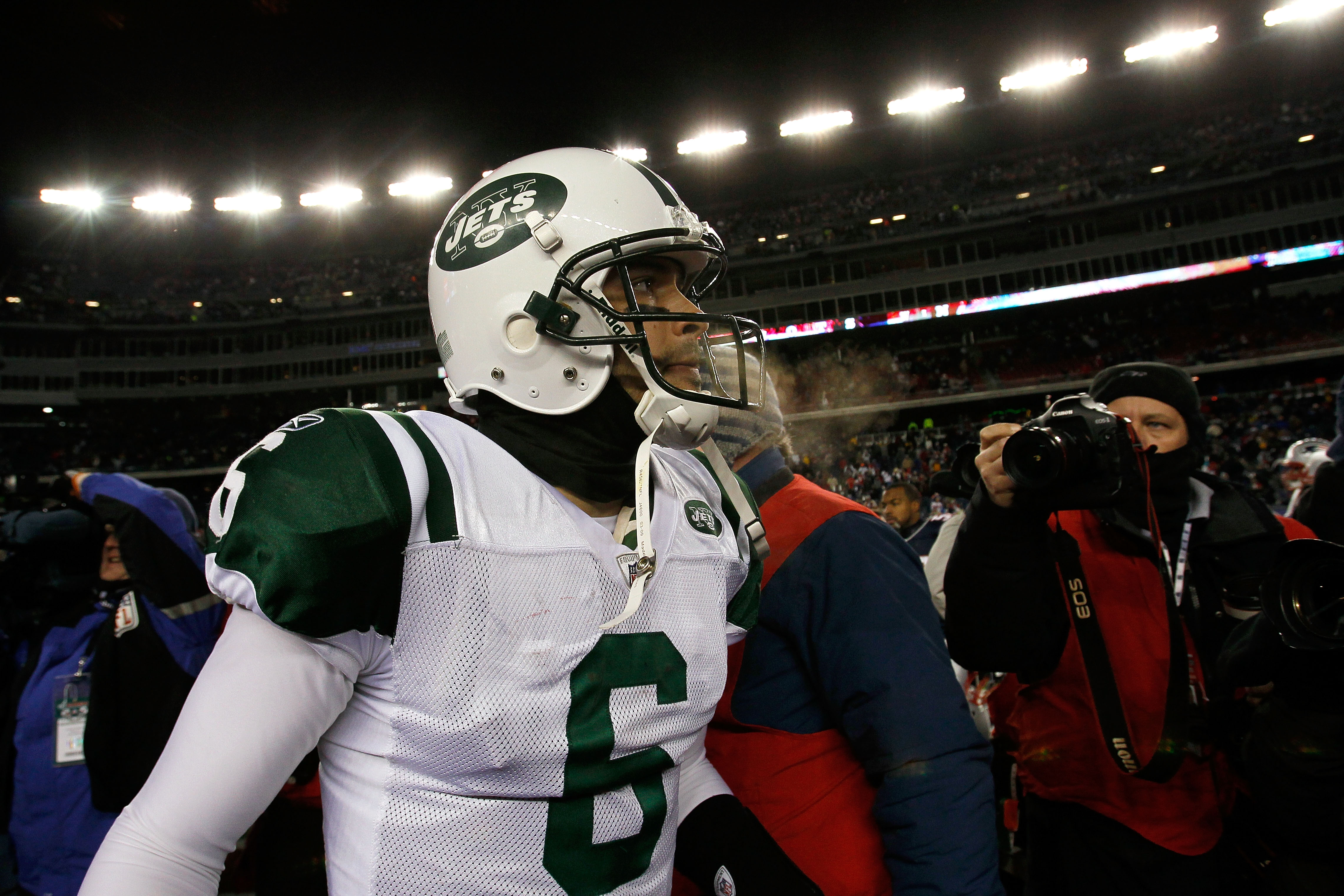 FOXBORO, MA - DECEMBER 06:  Mark Sanchez #6 of the New York Jets walks off the field dejected after the Jets loast 45-3 against the New England Patriots at Gillette Stadium on December 6, 2010 in Foxboro, Massachusetts.  (Photo by Jim Rogash/Getty Images)