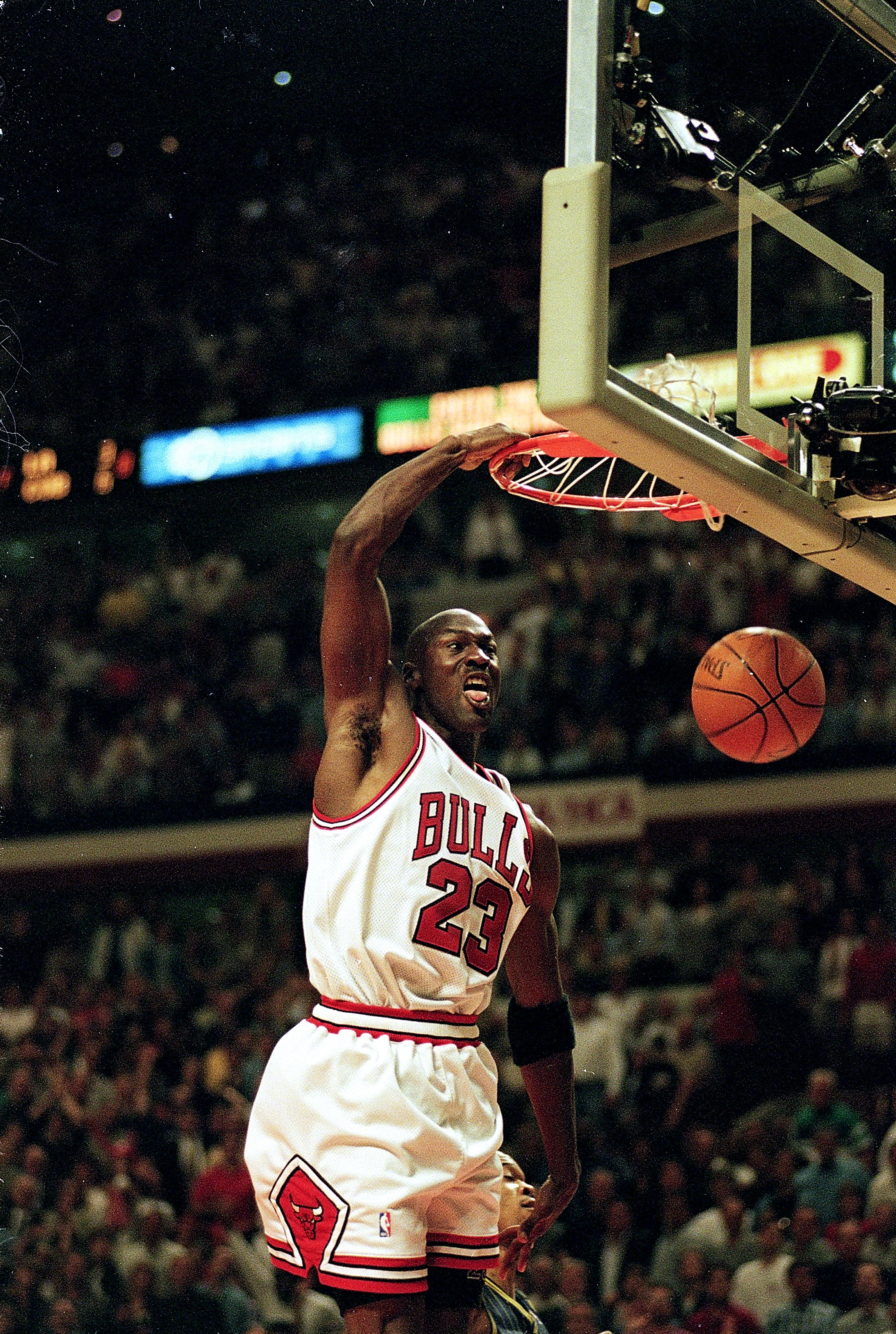 1a37437077e 19 May 1998  Michael Jordan  23 of the Chicago Bulls dunks the ball during