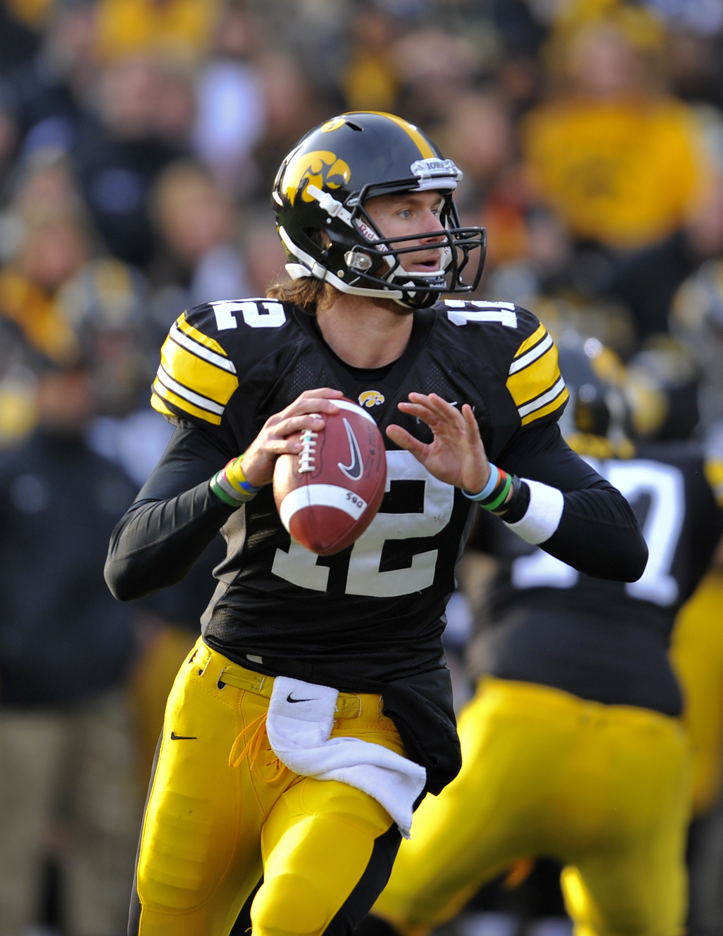 IOWA CITY, IA - NOVEMBER 20:  Quarterback Ricky Stanzi #12 of the University of Iowa Hawkeyes throws under pressure from Ohio State Buckeyes defenders during the first half of play at Kinnick Stadium on November 20, 2010 in Iowa City, Iowa. Ohio State won