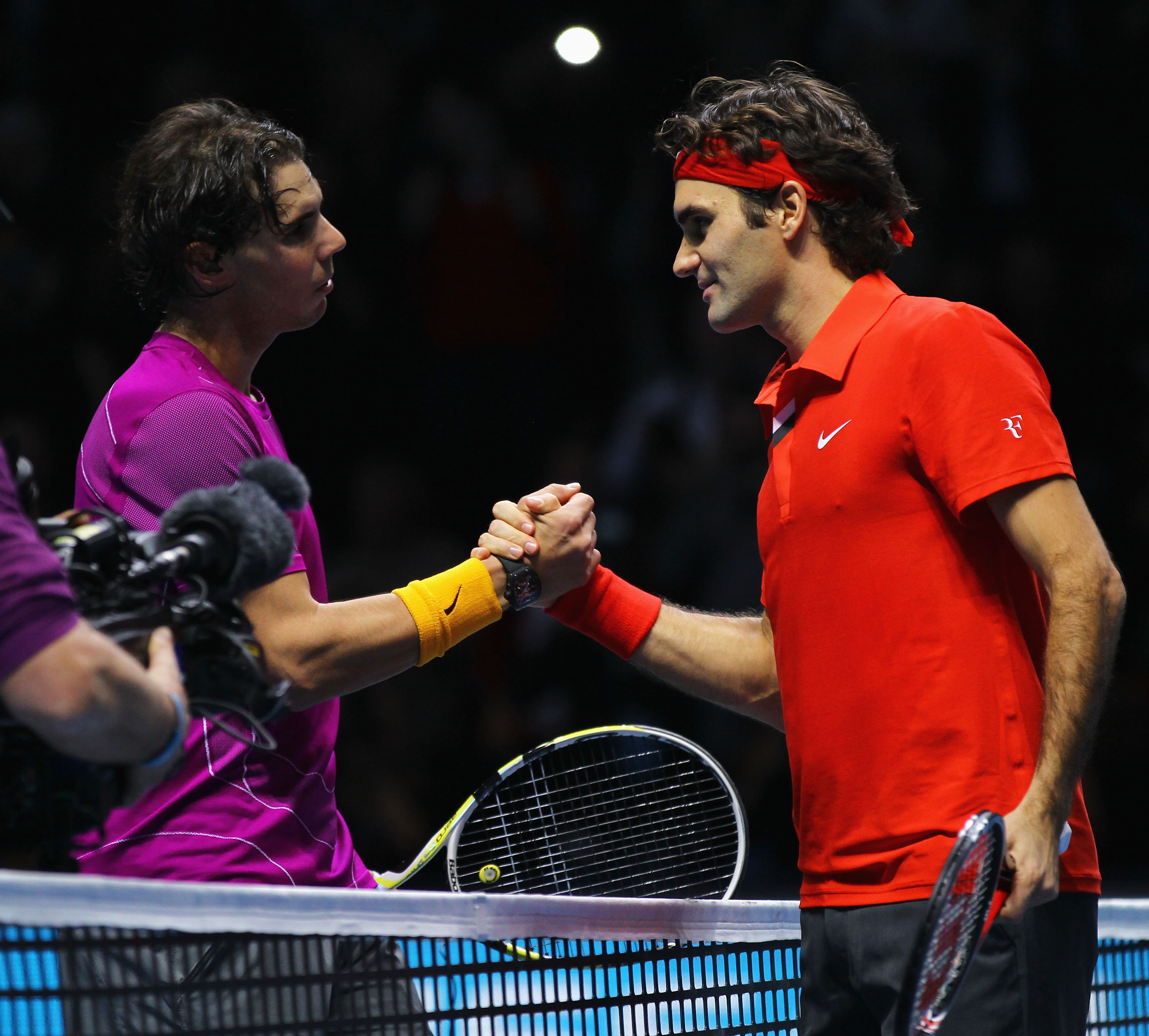LONDON, ENGLAND - NOVEMBER 28:  Roger Federer (R) of Switzerland is congratulated by Rafael Nadal of Spain after their men's final match during the ATP World Tour Finals at O2 Arena on November 28, 2010 in London, England.  (Photo by Matthew Lewis/Getty I