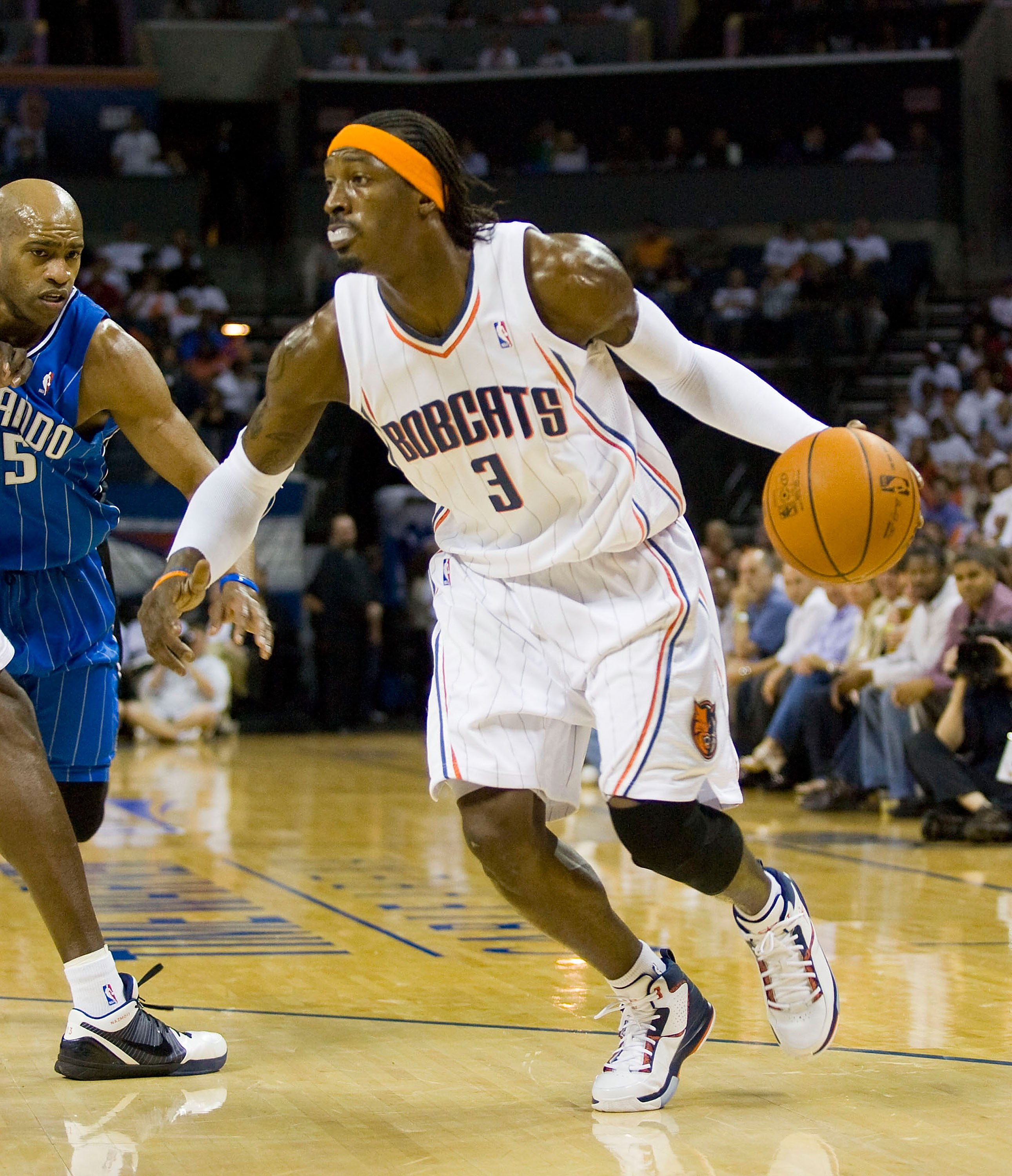 CHARLOTTE, NC - APRIL 26: Gerald Wallace #3 of the Charlotte Bobcats dribbles away from Vince Carter #15 of the Orlando Magic at Time Warner Cable Arena on April 26, 2010 in Charlotte, North Carolina.  The Magic defeated the Bobcats 99-90 to complete the