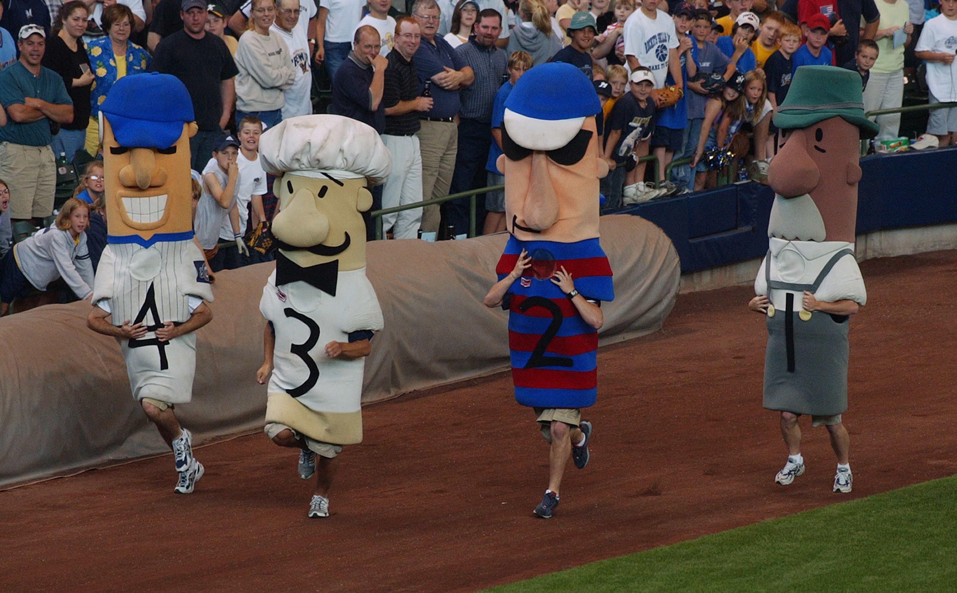 MILWAUKEE - JUNE 17:  A view of the Polish sausage, the Italian sausage, the Hot Dog, and the Bratwurst in the famous Sausage Race taken during the game between the Milwaukee Brewers and the Seattle Mariners on June 17, 2004 at Miller Park in Milwaukee, W