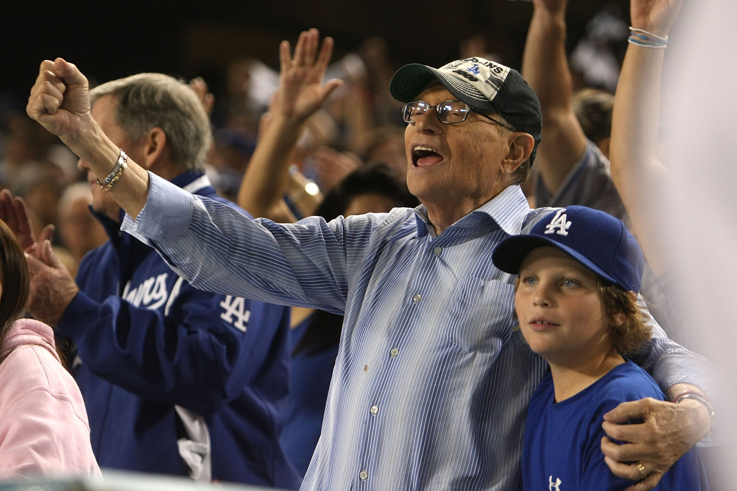 LOS ANGELES, CA - OCTOBER 15:  TV personality Larry King with son cheers on during the seventh inning stretch in Game One of the NLCS between the Philadelphia Phillies and the Los Angeles Dodgers during the 2009 MLB Playoffs at Dodger Stadium on October 1