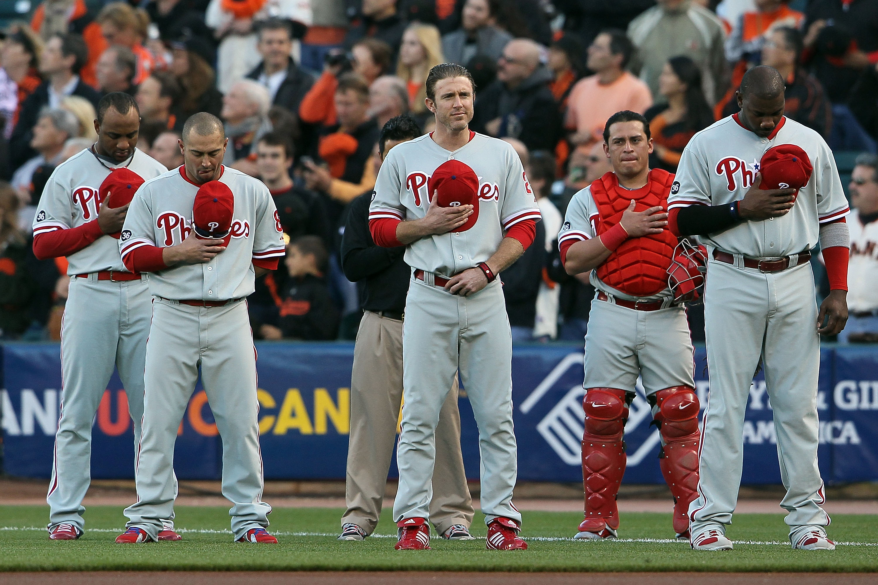 SAN FRANCISCO - OCTOBER 20:  (L-R) Ben Francisco #10, Shane Victorino #8, Chase Utley #26, Carlos Ruiz #51 and Ryan Howard #6 of the Philadelphia Phillies stand during the national anthem before Game Four of the NLCS during the 2010 MLB Playoffs against t