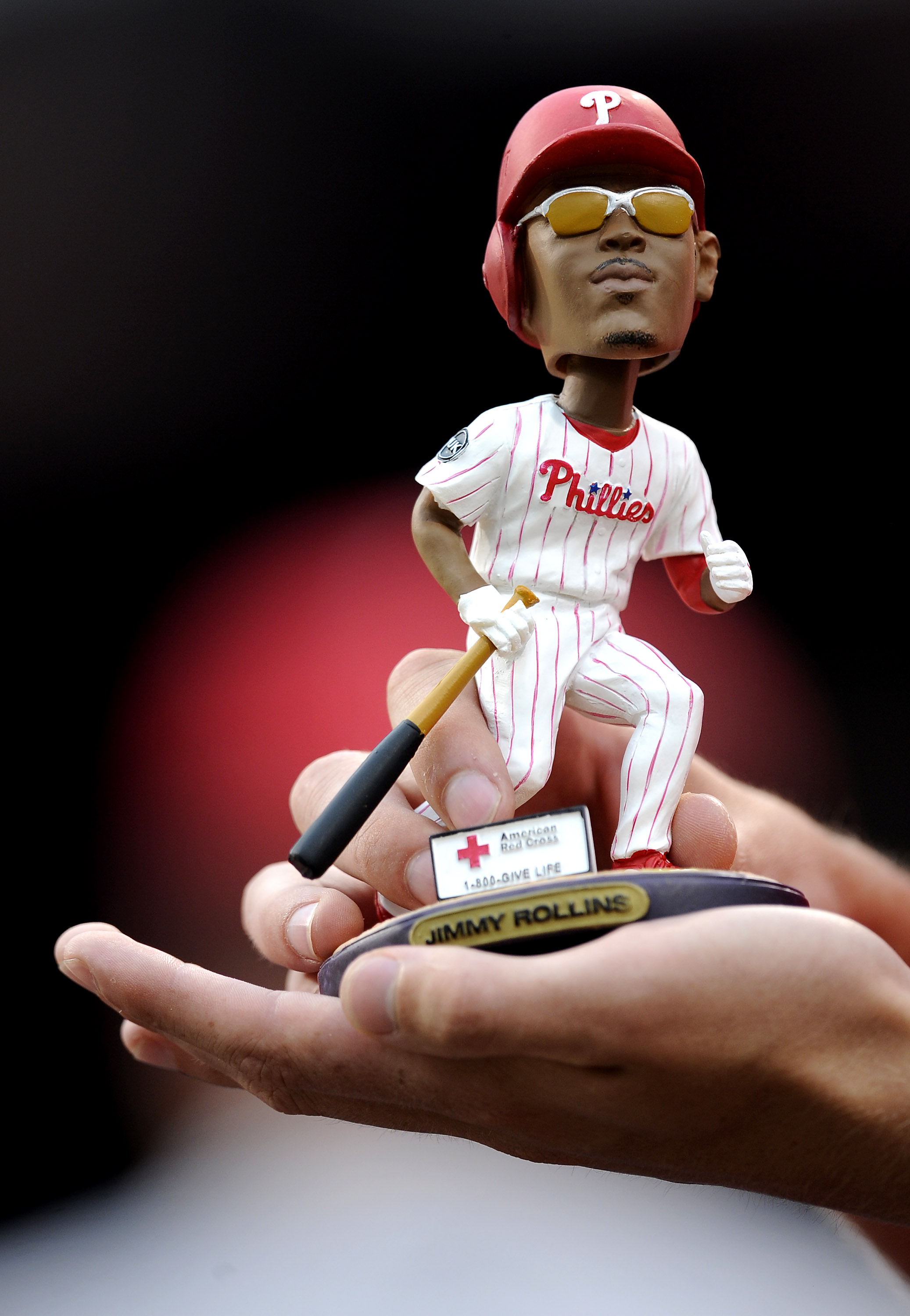 PHILADELPHIA - JUNE 4: A fan holds a bobblehead figure of Jimmy Rollins #11 of the Philadelphia Phillies before a game against the Cincinnati Reds at Citizens Bank Park June 4, 2008 in Philadelphia, Pennsylvania. (Photo by Jeff Zelevansky/Getty Images)