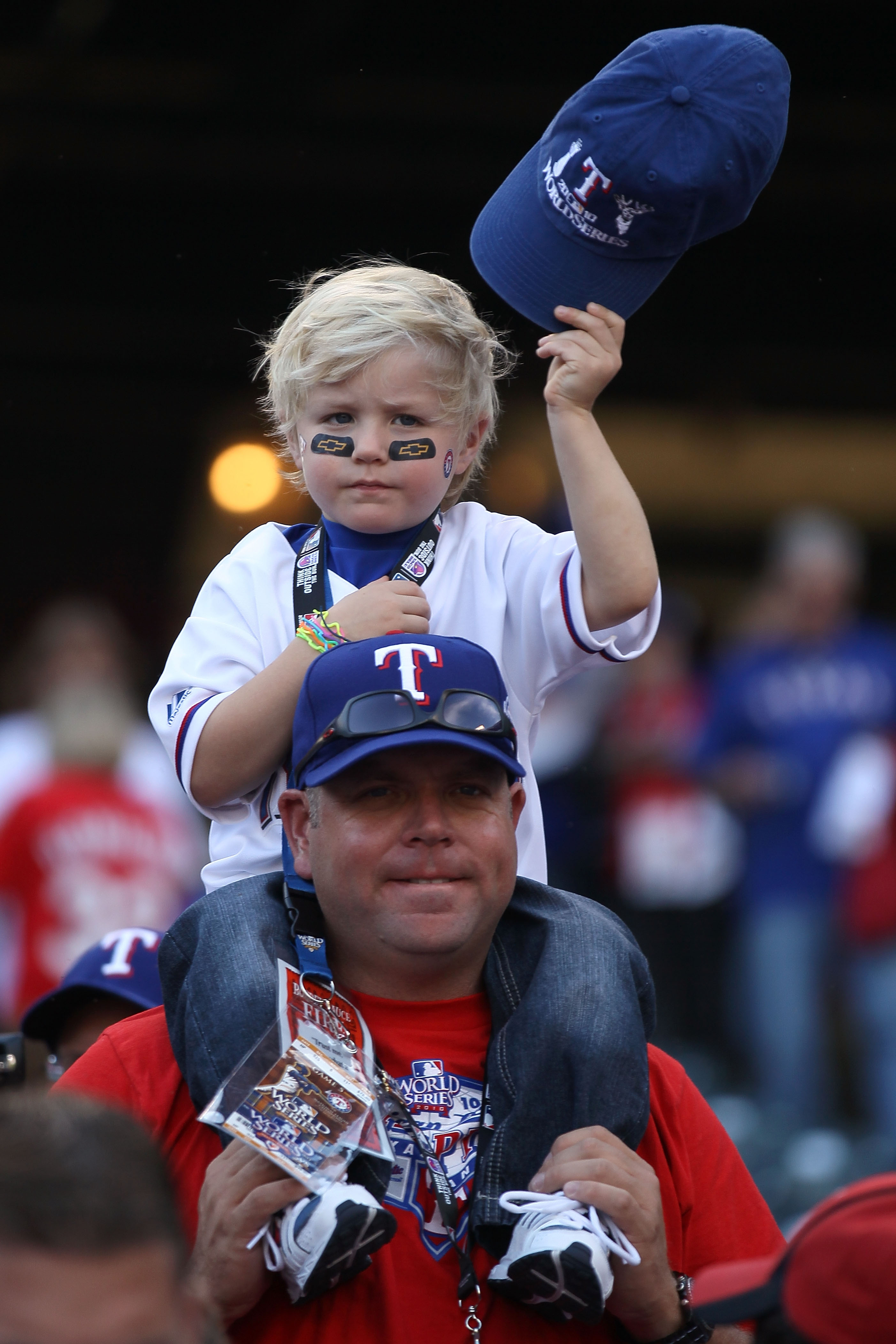 ARLINGTON, TX - NOVEMBER 01:  Fans of the Texas Rangers watch batting practice prior to the Rangers playing against the San Francisco Giants in Game Five of the 2010 MLB World Series at Rangers Ballpark in Arlington on November 1, 2010 in Arlington, Texas