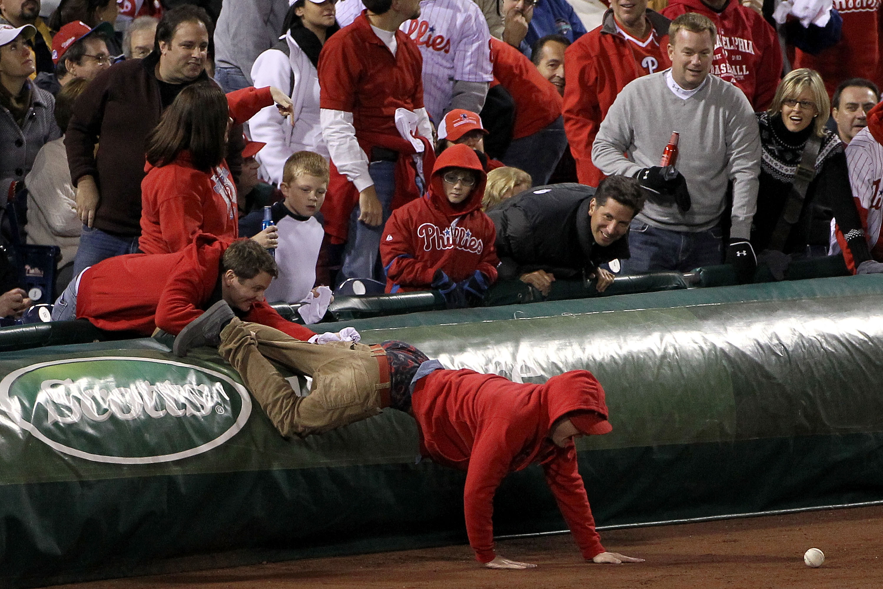 PHILADELPHIA - OCTOBER 16:  A fan goes after a foul ball in Game One of the NLCS during the 2010 MLB Playoffs between the San Francisco Giants and the Philadelphia Phillies at Citizens Bank Park on October 16, 2010 in Philadelphia, Pennsylvania.  (Photo b