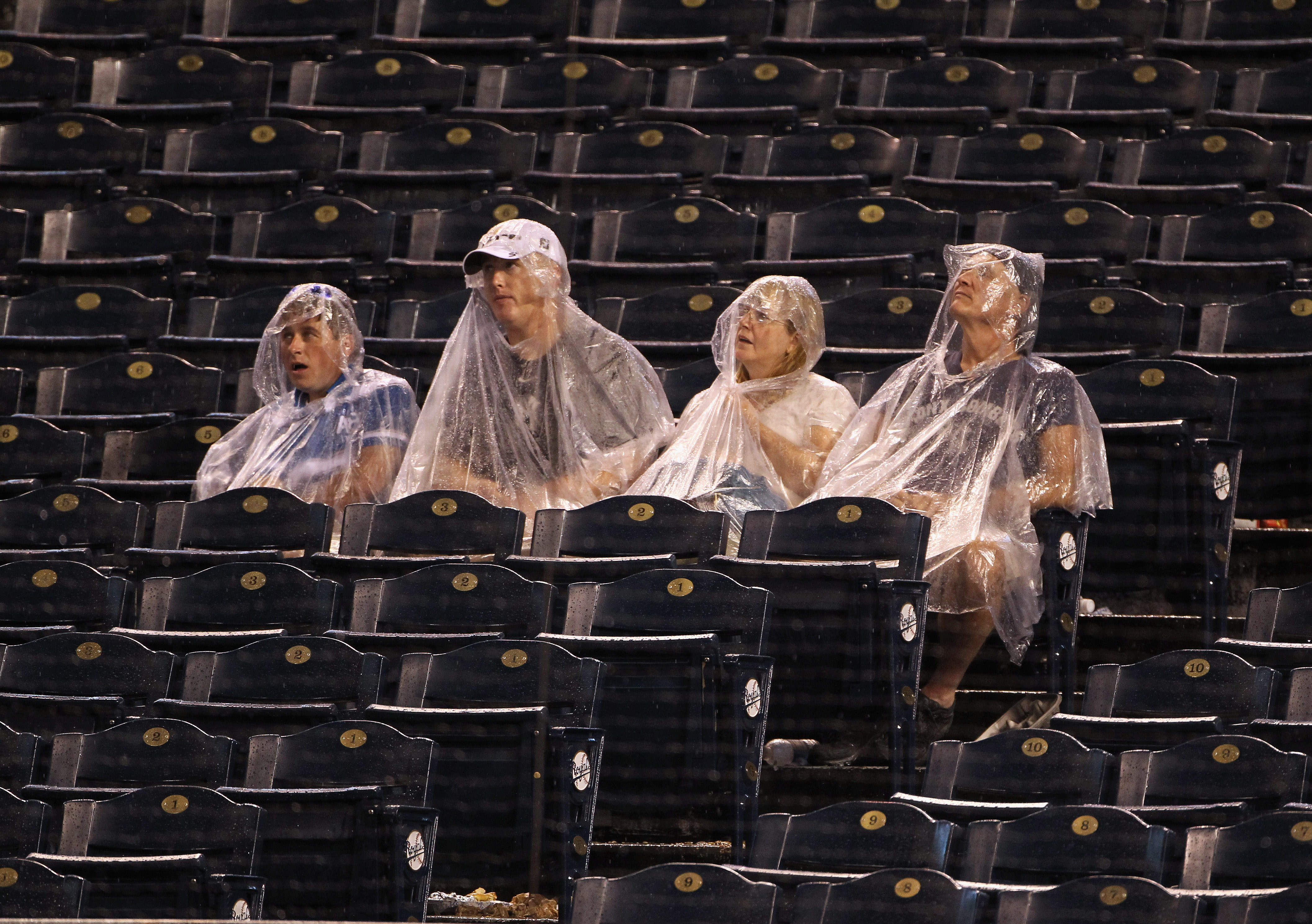 KANSAS CITY, MO - AUGUST 13:  Fans wait in the stands during a rain delay in the game between the New York Yankees and the Kansas City Royals on August 13, 2010 at Kauffman Stadium in Kansas City, Missouri.  (Photo by Jamie Squire/Getty Images)