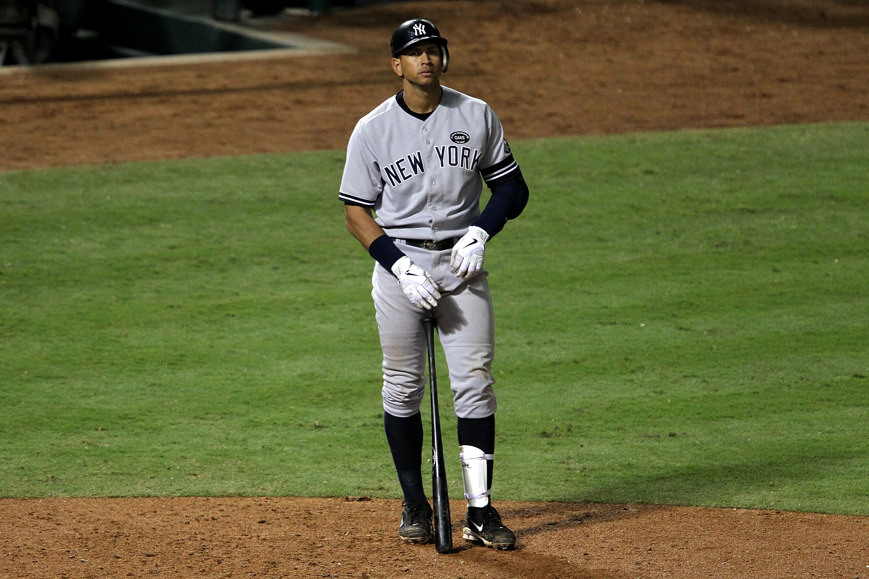 ARLINGTON, TX - OCTOBER 22:  Alex Rodriguez #13 of the New York Yankees stands outside the batters box during the ninth inning of Game Six of the ALCS against the Texas Rangers during the 2010 MLB Playoffs at Rangers Ballpark in Arlington on October 22, 2