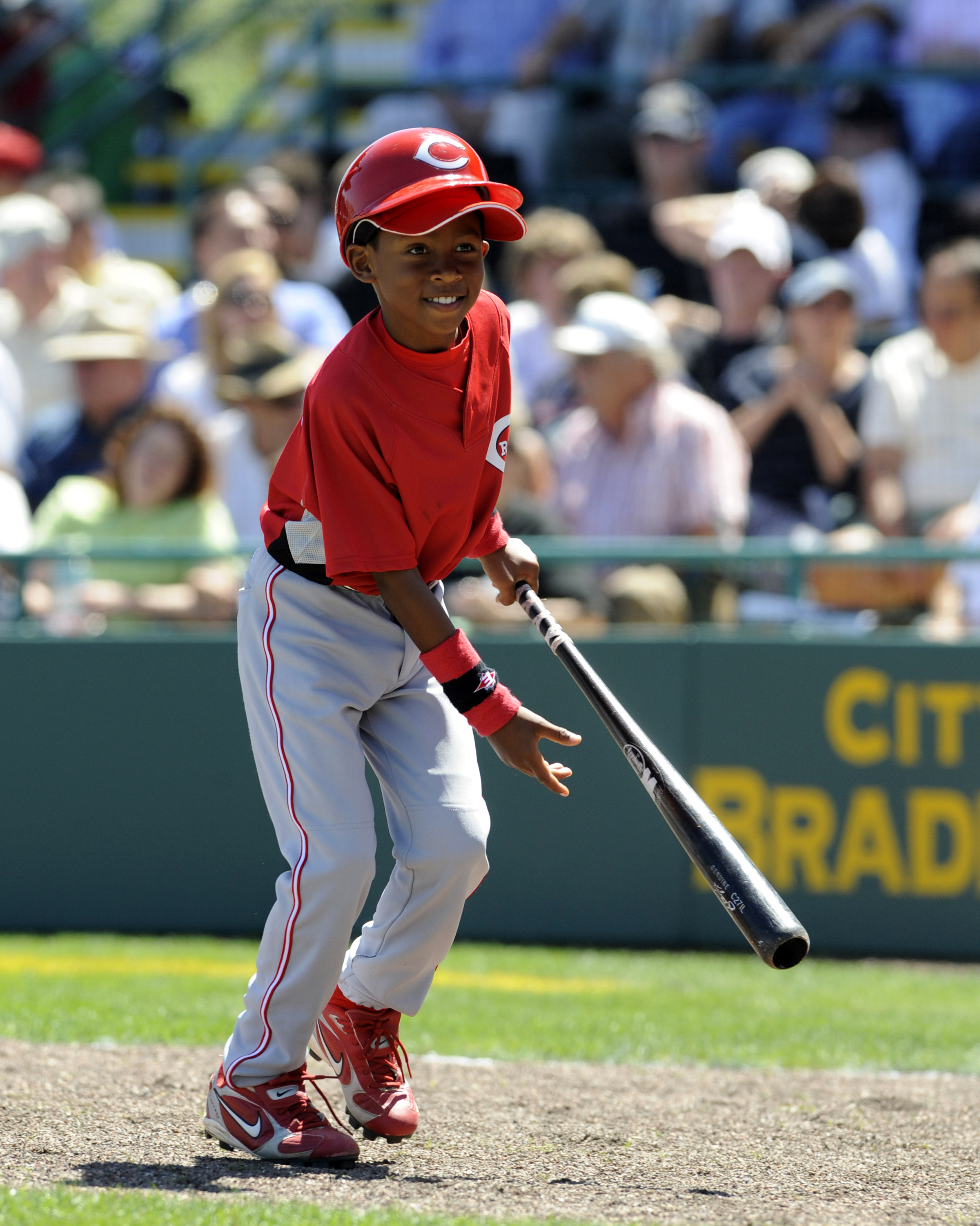 BRADENTON, FL - MARCH 21: Nine-year-old batboy Darren Baker of the Cincinnati Reds retrieves a bat against the Pittsburgh Pirates March 21, 2008 at McKechnie Field in Bradenton, Florida.  Darren is the son of manager Dusty Baker. (Photo by Al Messerschmid