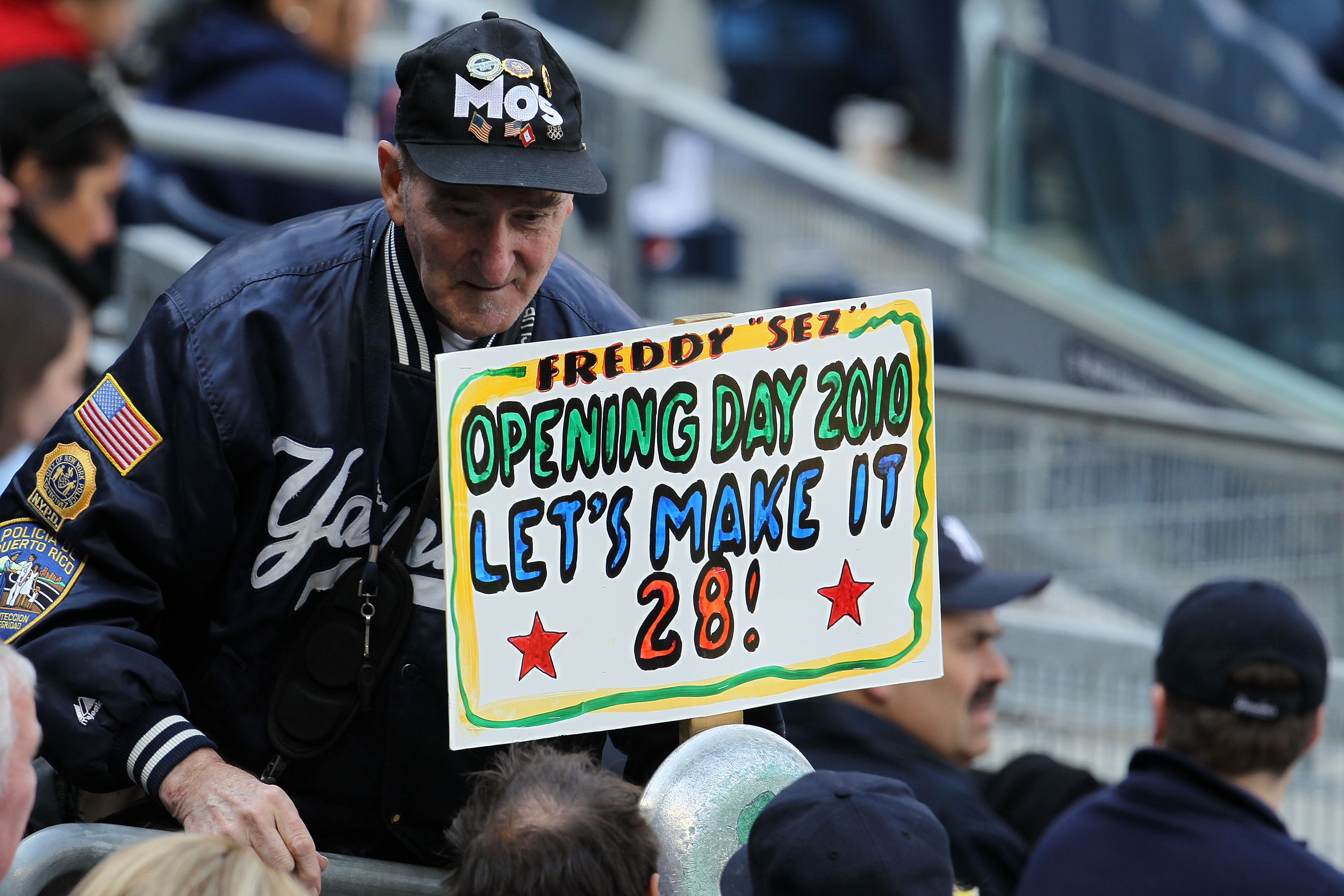 NEW YORK - APRIL 13:  Super fan Freddy Sez holds up a sign reading 'Opening Day 2010 Let's Makes It 28!' as the New York Yankees play against the Los Angeles Angels of Anaheim during the Yankees home opener at Yankee Stadium on April 13, 2010 in the Bronx