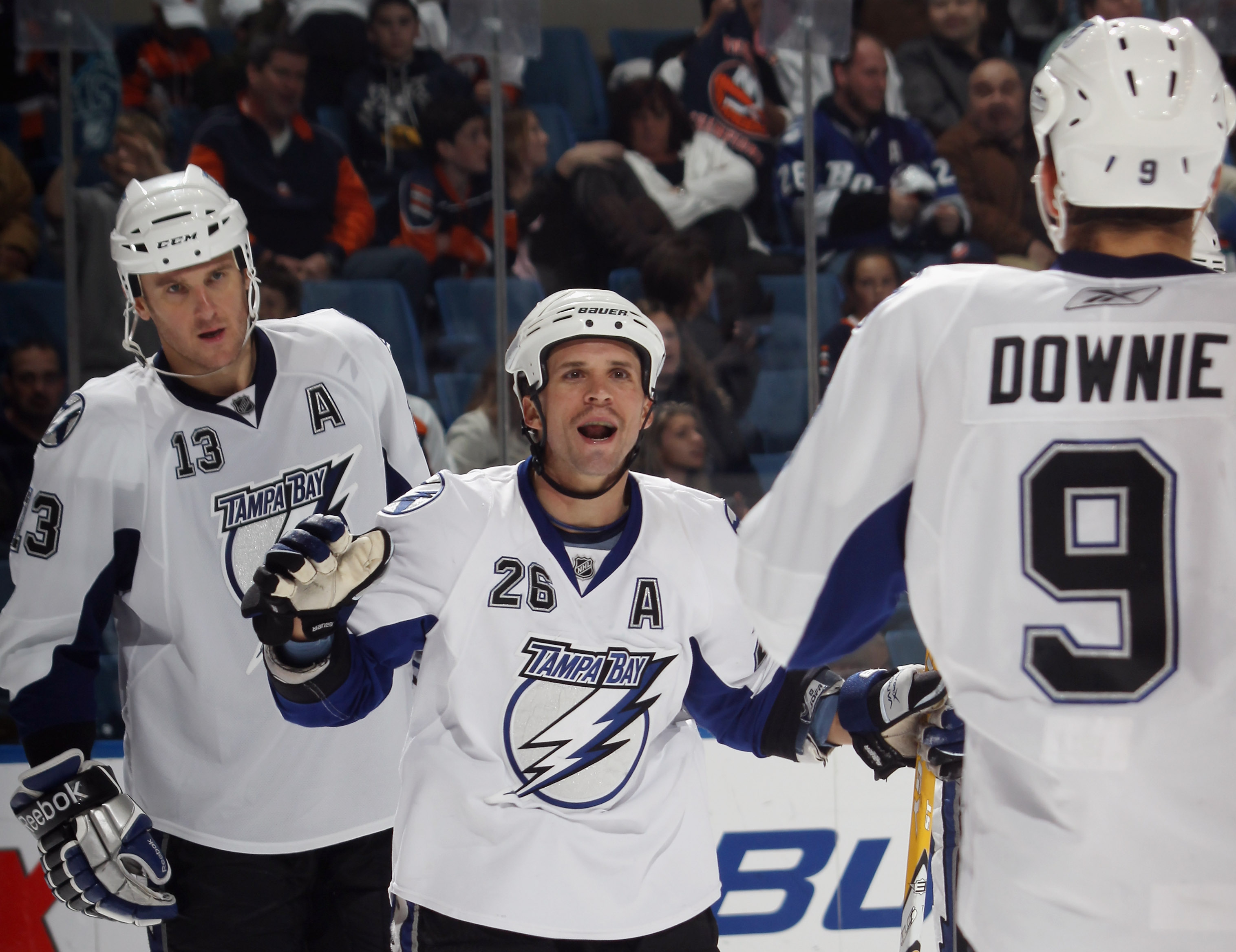 UNIONDALE, NY - NOVEMBER 17:  Martin St. Louis #26 of the Tampa Bay Lightning scores at 18:31 of the third period aganst the New York Islanders at the Nassau Coliseum on November 17, 2010 in Uniondale, New York. The Lightning defeated the Islanders 4-2.