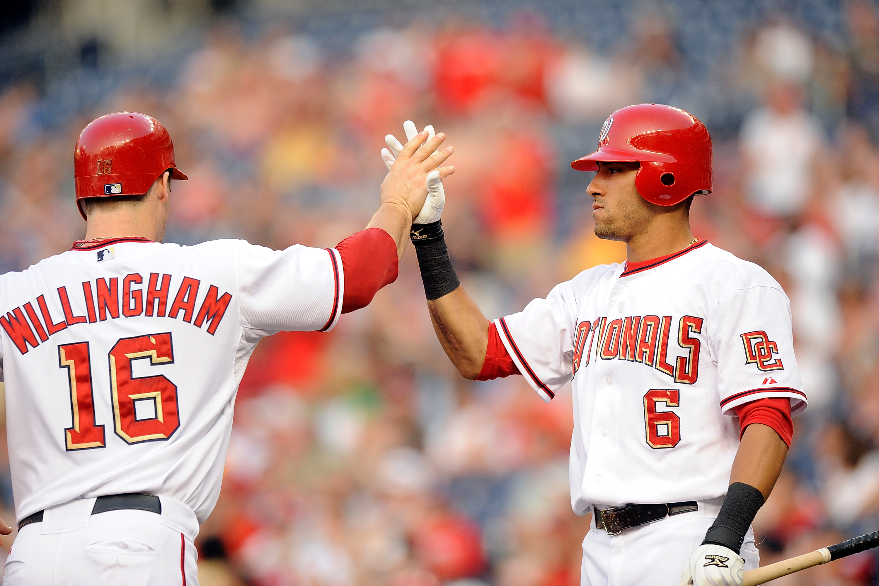 WASHINGTON - JULY 06:  Josh Willingham #16 of the Washington Nationals is congratulated by Ian Desmond #6 after scoring in the first inning against the San Diego Padres at Nationals Park on July 6, 2010 in Washington, DC.  (Photo by Greg Fiume/Getty Image