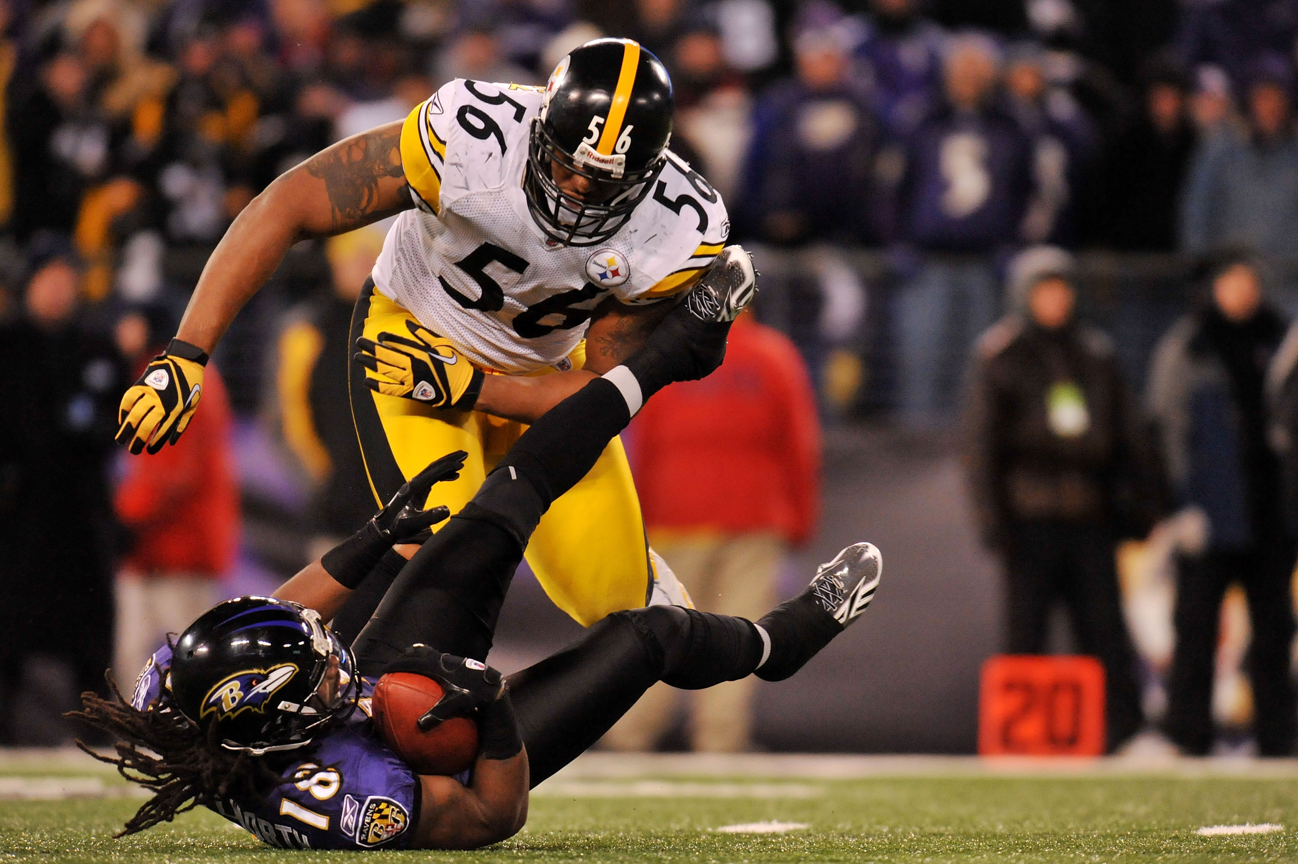 BALTIMORE, MD - DECEMBER 05:  Wide receiver Donte' Stallworth #18 of the Baltimore Ravens is tackeled behind the line of scrimmage by linebacker LaMarr Woodley #56 of the Pittsburgh Steelers during the fourth quarter of the game at M&T Bank Stadium on Dec