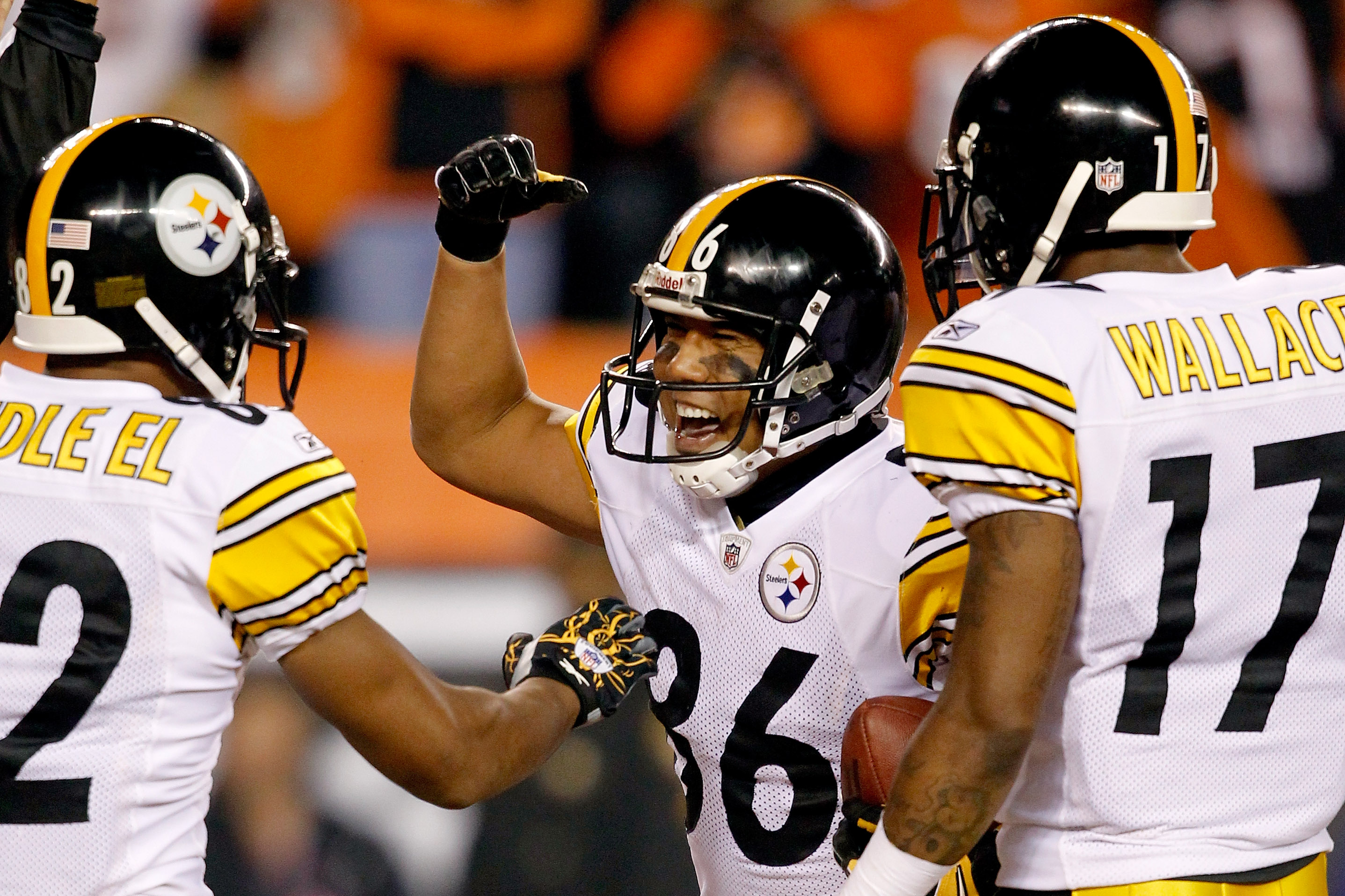 CINCINNATI - NOVEMBER 08:  Hines Ward #86 of the Pittsburgh Steelers celebrates in the endzone with Antwaan Randle El #82 and Mike Wallace #17 after scoring a touchdown against the Cincinnati Bengals at Paul Brown Stadium on November 8, 2010 in Cincinnati