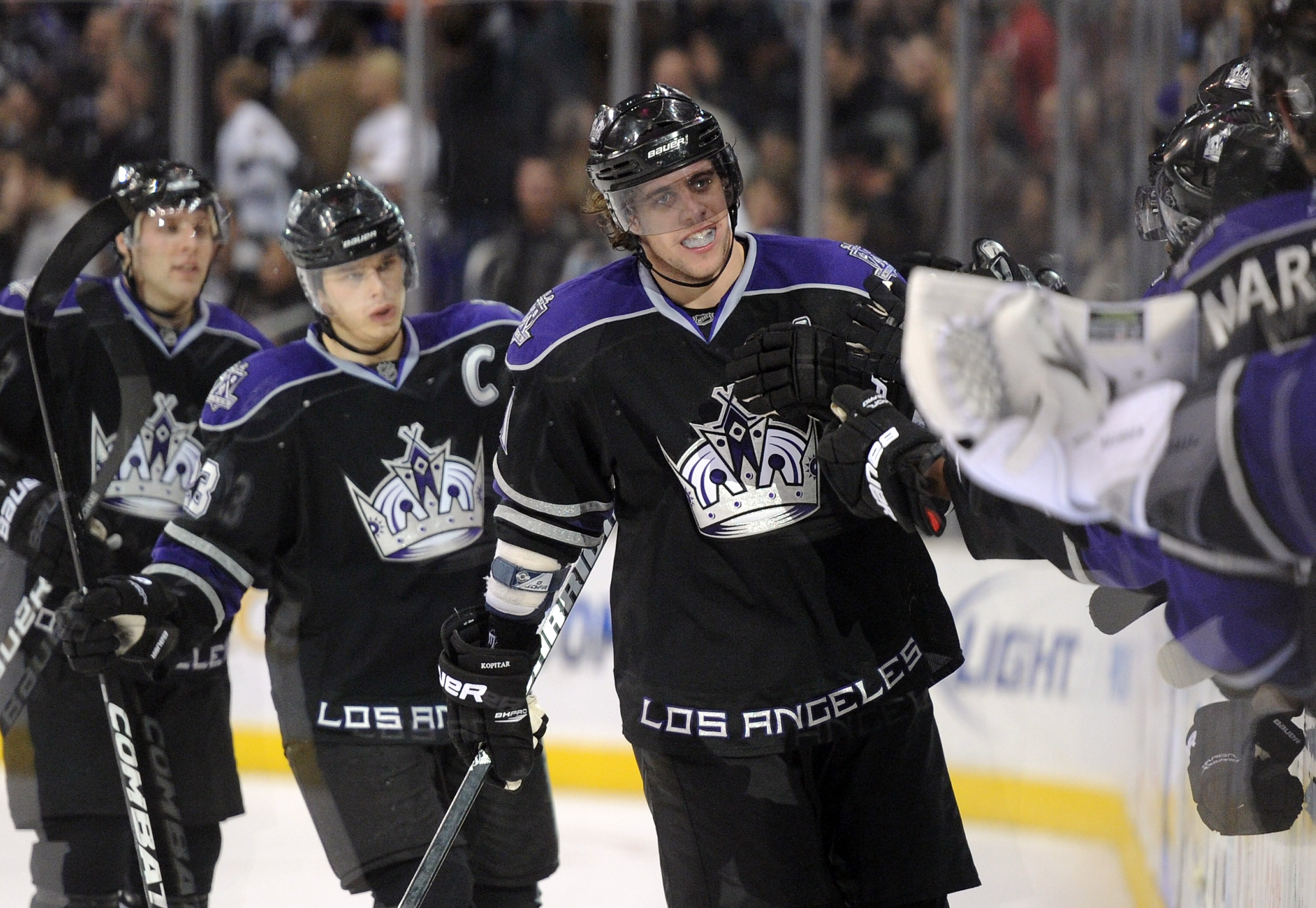 LOS ANGELES, CA - DECEMBER 02:  Anze Kopitar #11 of the Los Angeles Kings celebrates his goal with the bench for a 3-2 win over the Florida Panthers at the Staples Center on December 2, 2010 in Los Angeles, California.  (Photo by Harry How/Getty Images)