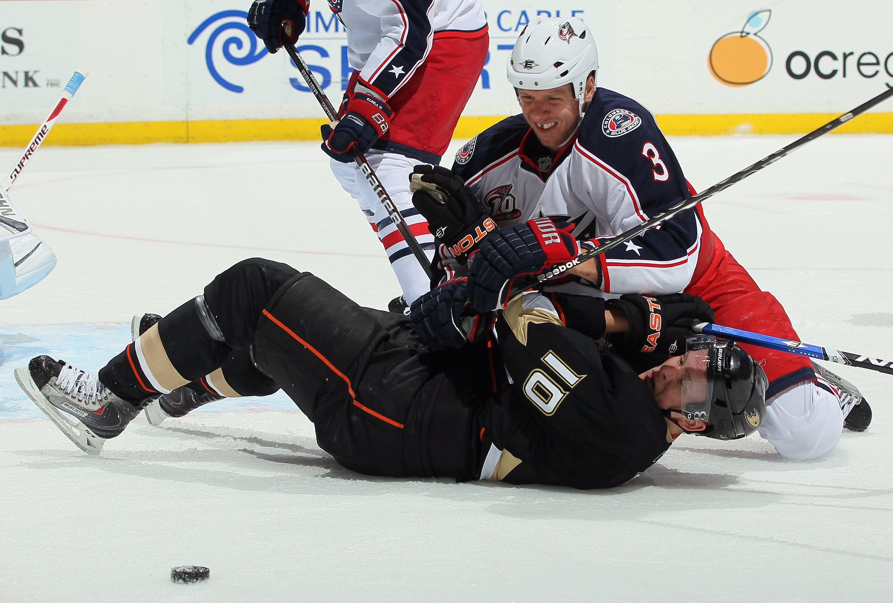 ANAHEIM, CA - NOVEMBER 19:  Marc Methot #3 of the Columbus Blue Jackets and Corey Perry #10 of the Anaheim Ducks get tangled up during the first period at the Honda Center on November 19, 2010 in Anaheim, California.  (Photo by Jeff Gross/Getty Images)