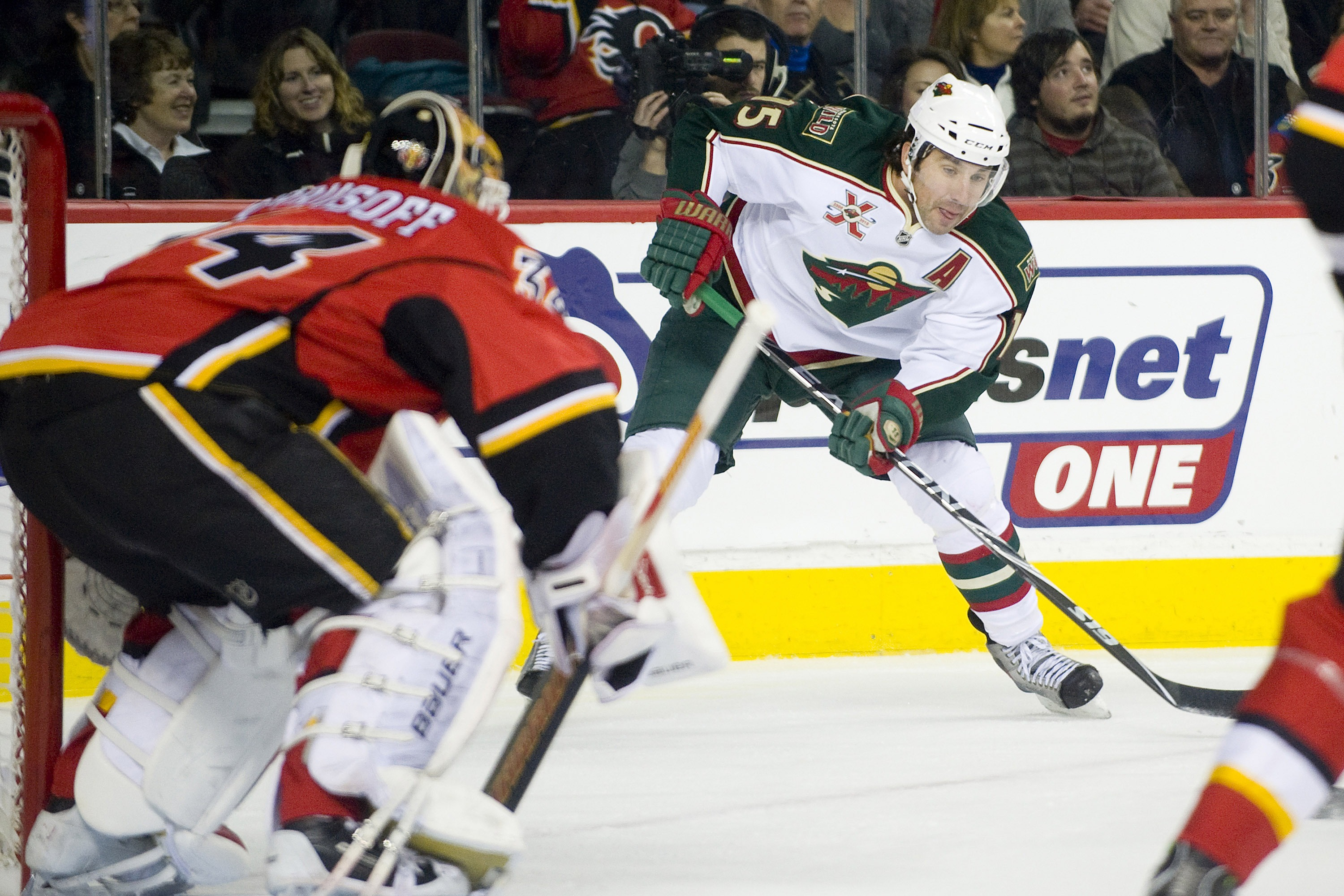 EDMONTON, AB - NOVEMBER 29:  Andrew Brunette #15 of the Minnesota Wild carries the puck in the corner against the Calgary Flames at Scotiabank Saddledome on November 29, 2010 in Calgary, Alberta, Canada. The Flames beat the Wild 3-0.  (Photo by Dylan Lync