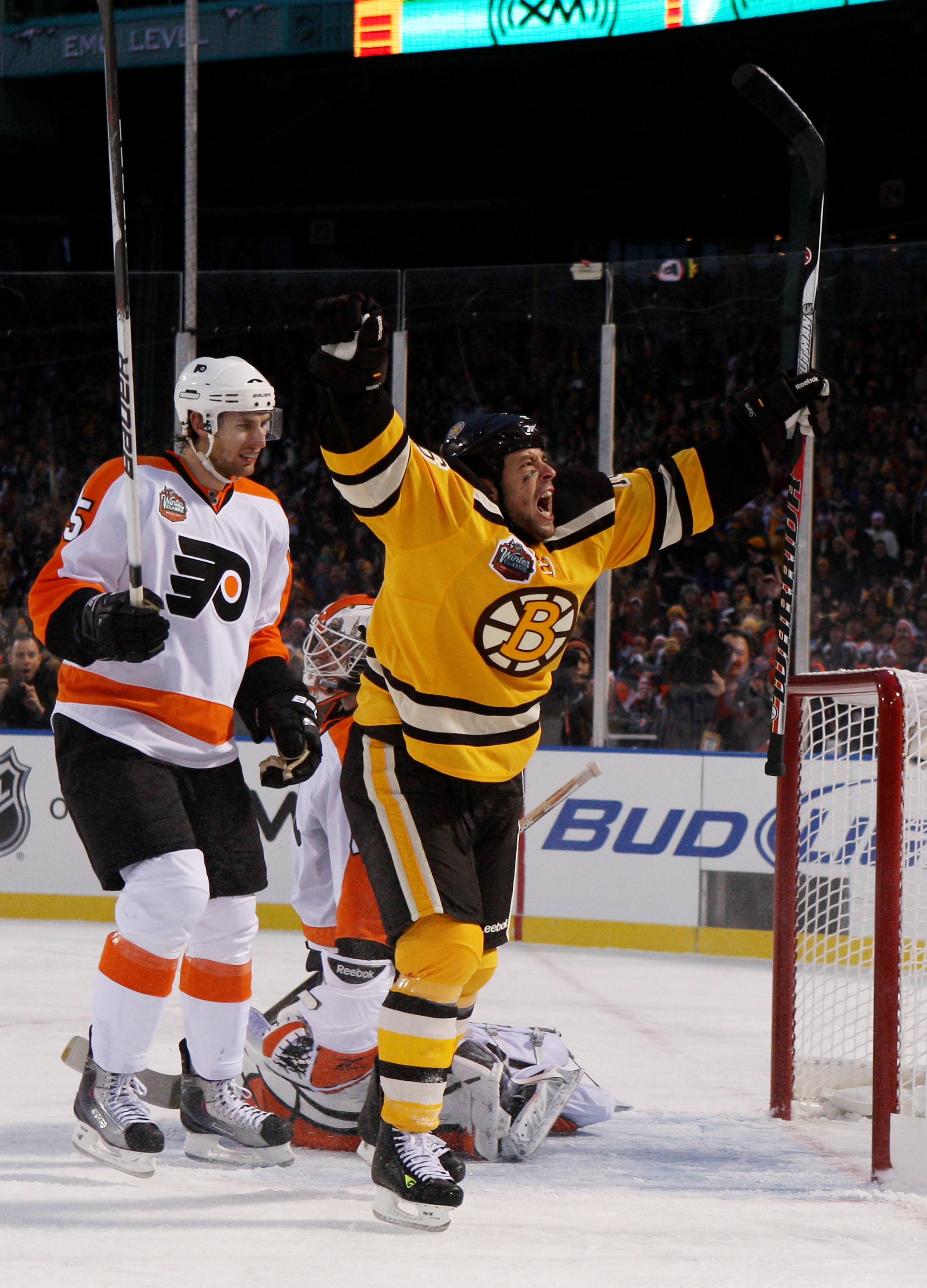 BOSTON - JANUARY 01:  Marco Sturm #16 of the Boston Bruins celebrates scoring a goal to defeat the Philadelphia Flyers 2-1 in overtime during the 2010 Bridgestone Winter Classic at Fenway Park on January 1, 2010 in Boston, Massachusetts.  (Photo by Jim Mc