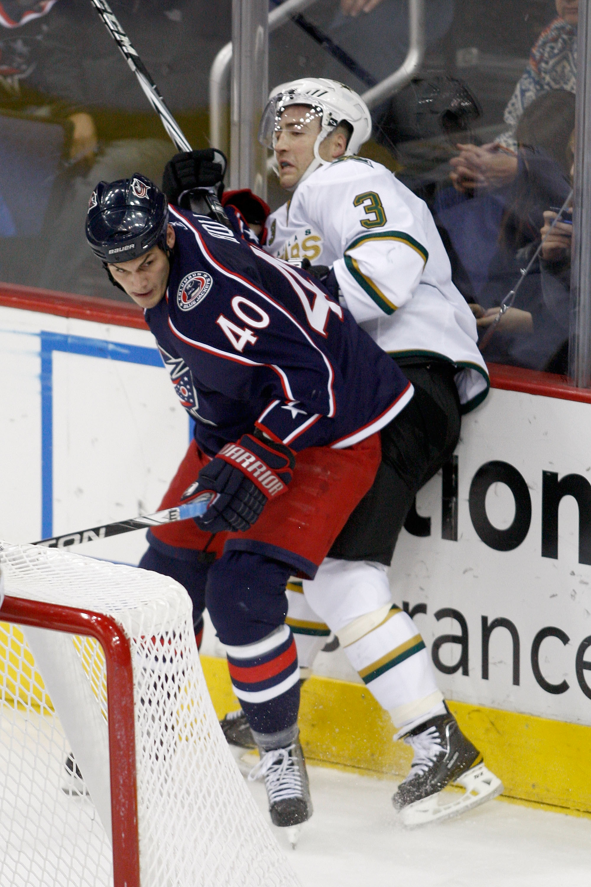 COLUMBUS, OH - DECEMBER 6:  Jared Boll #40 of the Columbus Blue Jackets checks Stephane Robidas #3 of the Dallas Stars during the third period on December 6, 2010 at Nationwide Arena in Columbus, Ohio.  Columbus defeated Dallas 3-2 in a shootout.  (Photo