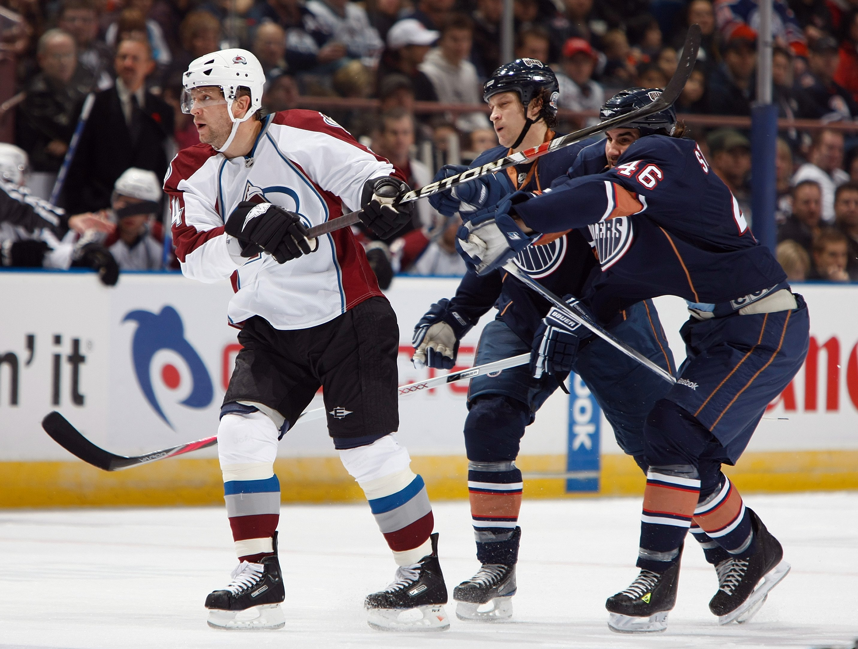 EDMONTON, CANADA - NOVEMBER 15:  Ruslan Salei #24 of the Colorado Avalanche tangles with Zach Stortini #46 of the Edmonton Oilers during their NHL game on November 15, 2008 at Rexall Place in Edmonton, Alberta, Canada. The Avalanche defeated the Oilers 3-