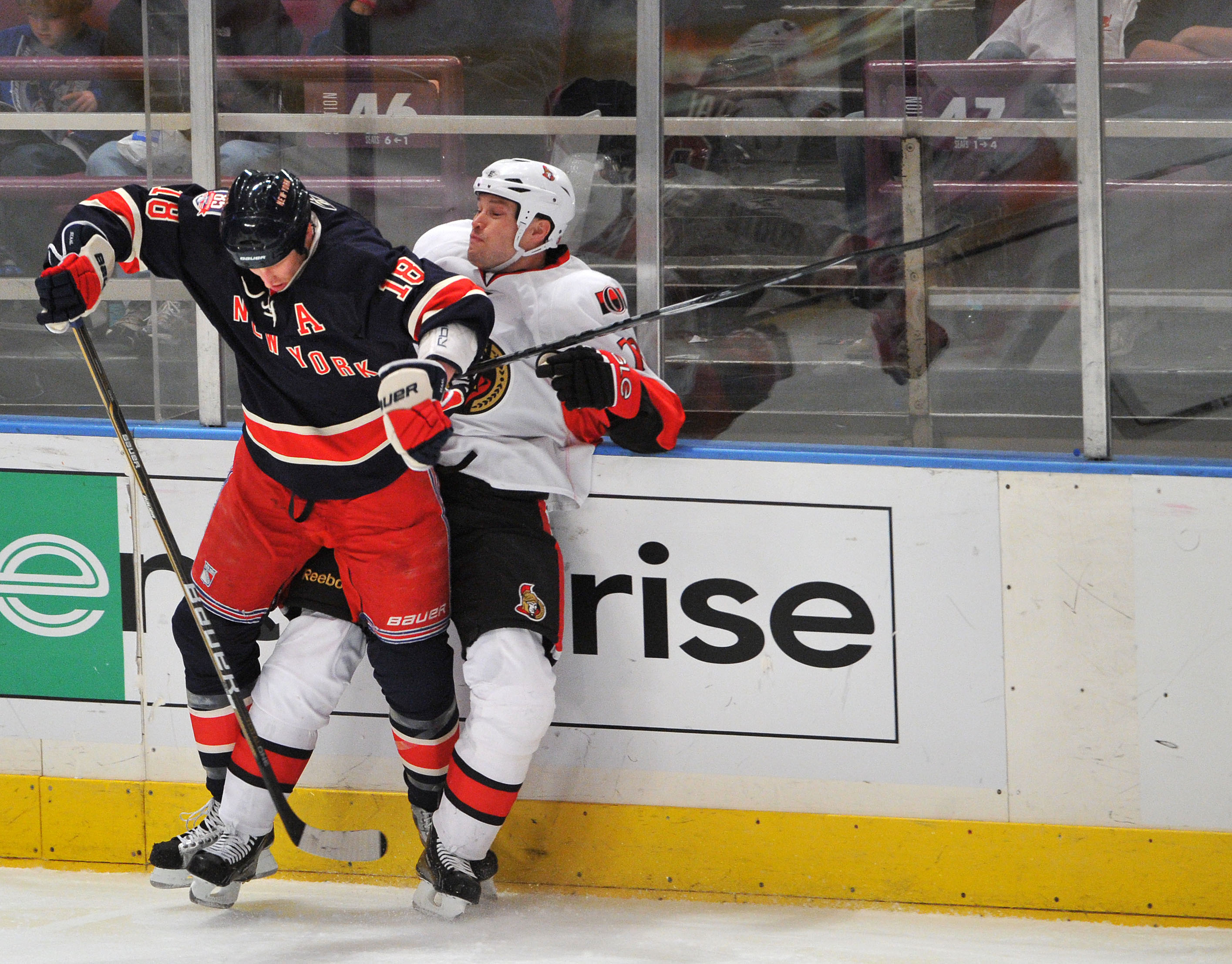 NEW YORK, NY - DECEMBER 5: Marc Staal #18 of the New York Rangers checks Jarkko Ruutu #73 of the Ottawa Senators during the third period at Madison Square Garden on December 5, 2010 in New York City. (Photo by Christopher Pasatieri/Getty Images)