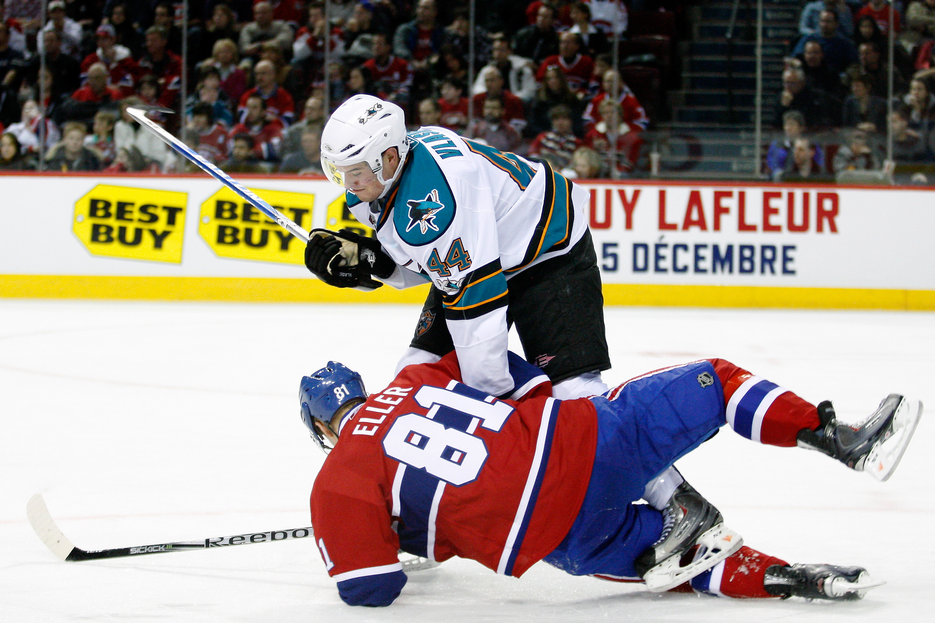 MONTREAL- DECEMBER 4:  Marc-Edouard Vlasic #44 of the San Jose Sharks body checks Lars Eller #81 of the Montreal Canadiens during the NHL game at the Bell Centre on December 4, 2010 in Montreal, Quebec, Canada.  The Canadiens defeated the Sharks 3-1.  (Ph