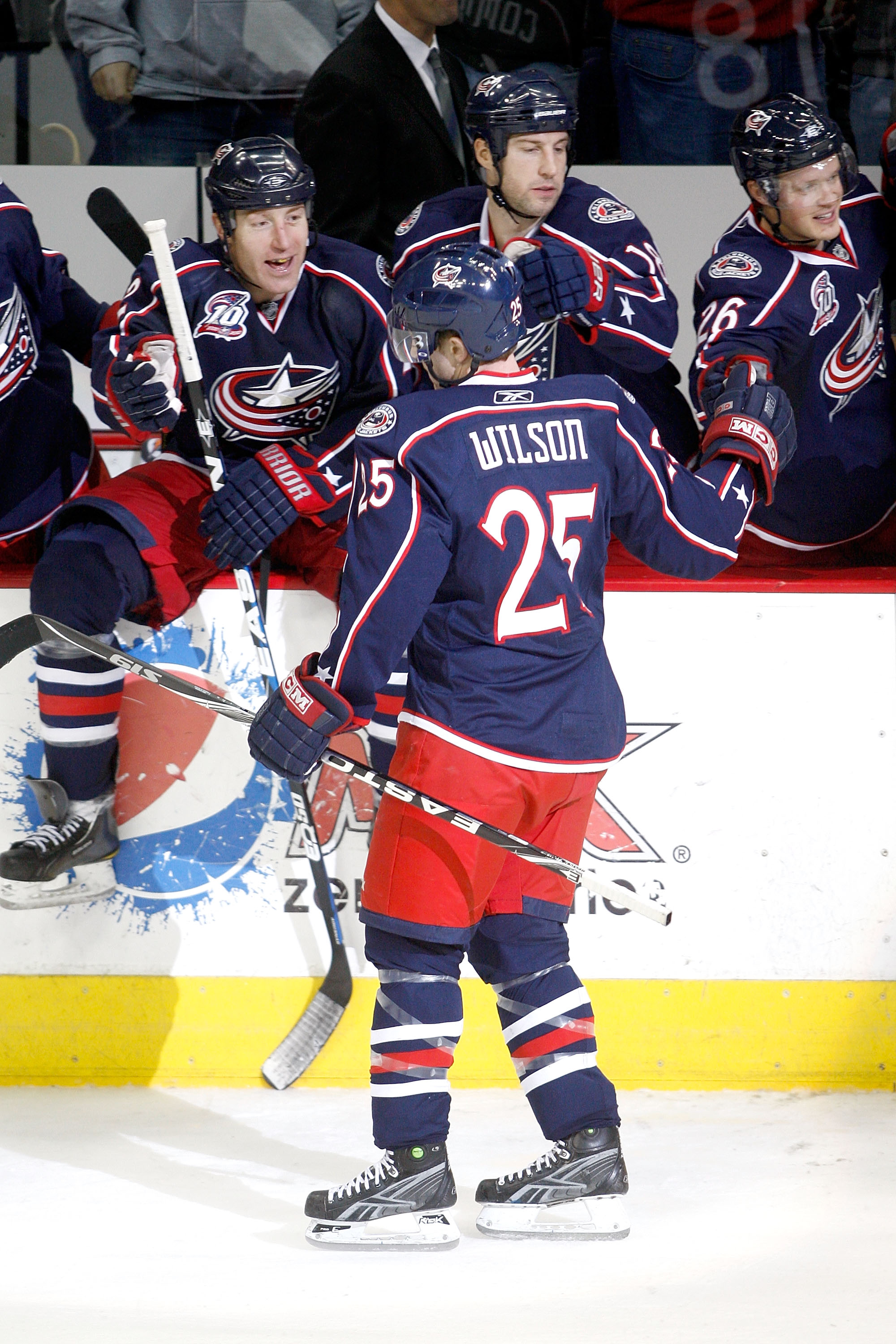 COLUMBUS, OH - DECEMBER 6:  Kyle Wilson #25 of the Columbus Blue Jackets is congratulated by his teammates after scoring the game winning goal against the Dallas Stars in a shootout on December 6, 2010 at Nationwide Arena in Columbus, Ohio.  Columbus defe