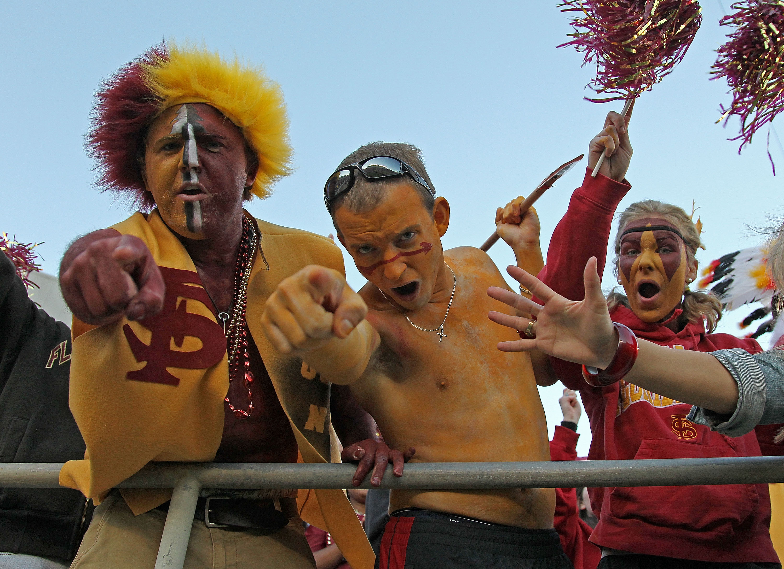 TALLAHASSEE, FL - NOVEMBER 27:  Florida State Seminoles fans celebrate after a touchdown during a game against the Florida Gators at Doak Campbell Stadium on November 27, 2010 in Tallahassee, Florida.  (Photo by Mike Ehrmann/Getty Images)