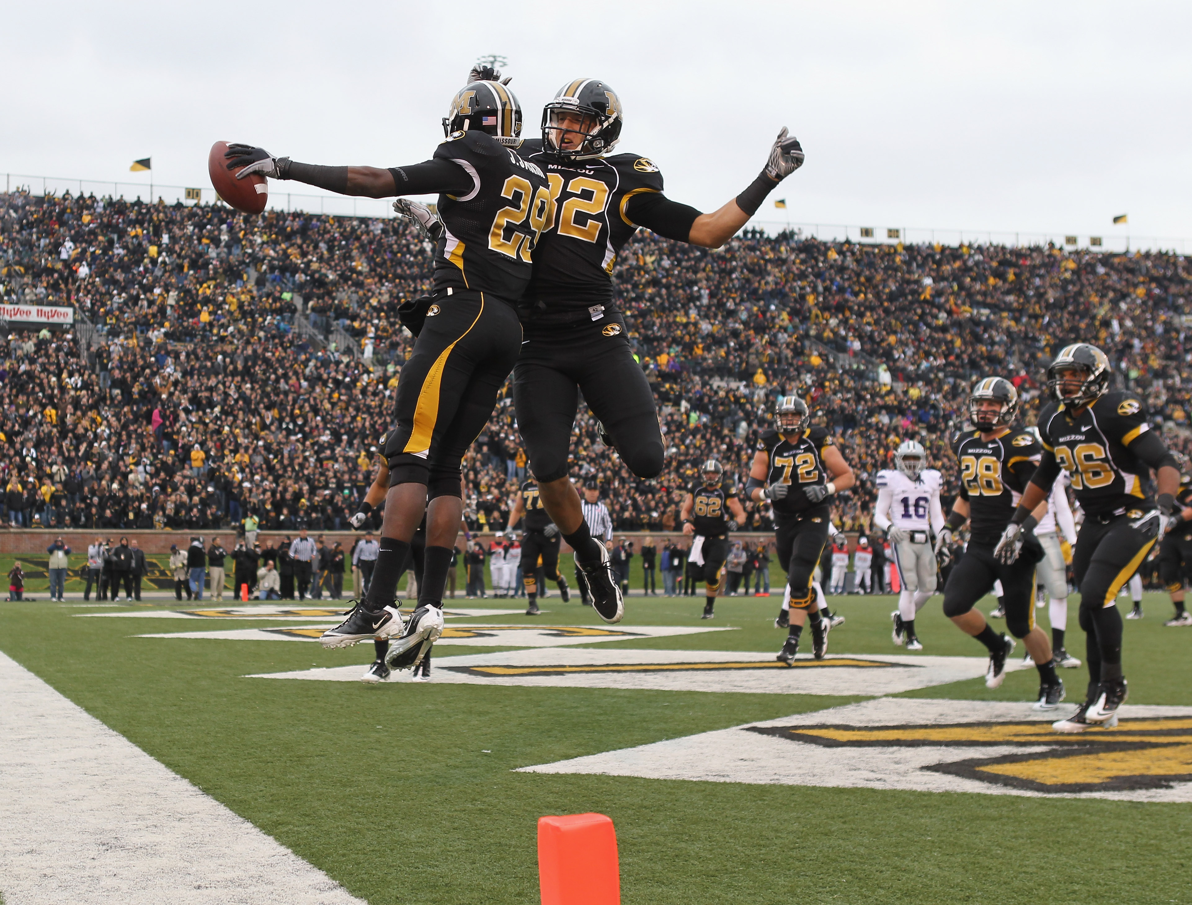 COLUMBIA, MO - NOVEMBER 13:  Michael Egnew #82  of the Missouri Tigers congratulates Jerrell Jackson #29 with a chest bump after Jackson carried for a touchdown during the game against the Kansas State Wildcats on November 13, 2010 at Faurot Field/Memoria