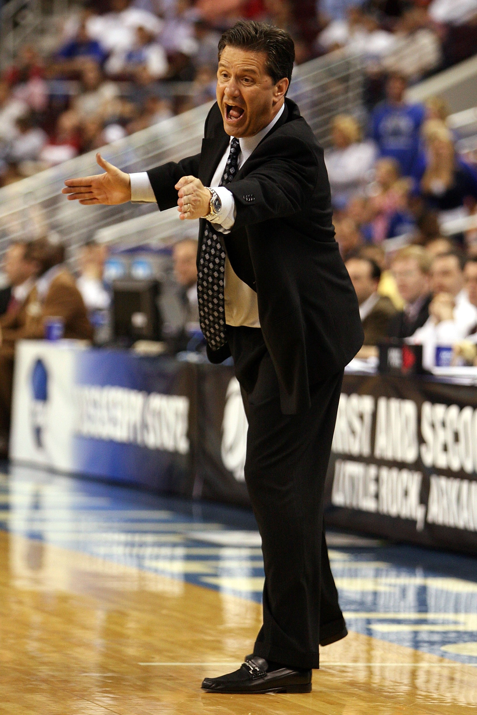 NORTH LITTLE ROCK, AR - MARCH 23:  Head coach John Calipari of the Memphis Tigers reacts against the Mississippi State Bulldogs during the second round of the South Regional as part of the 2008 NCAA Men's Basketball Tournament at Alltel Arena on March 23,