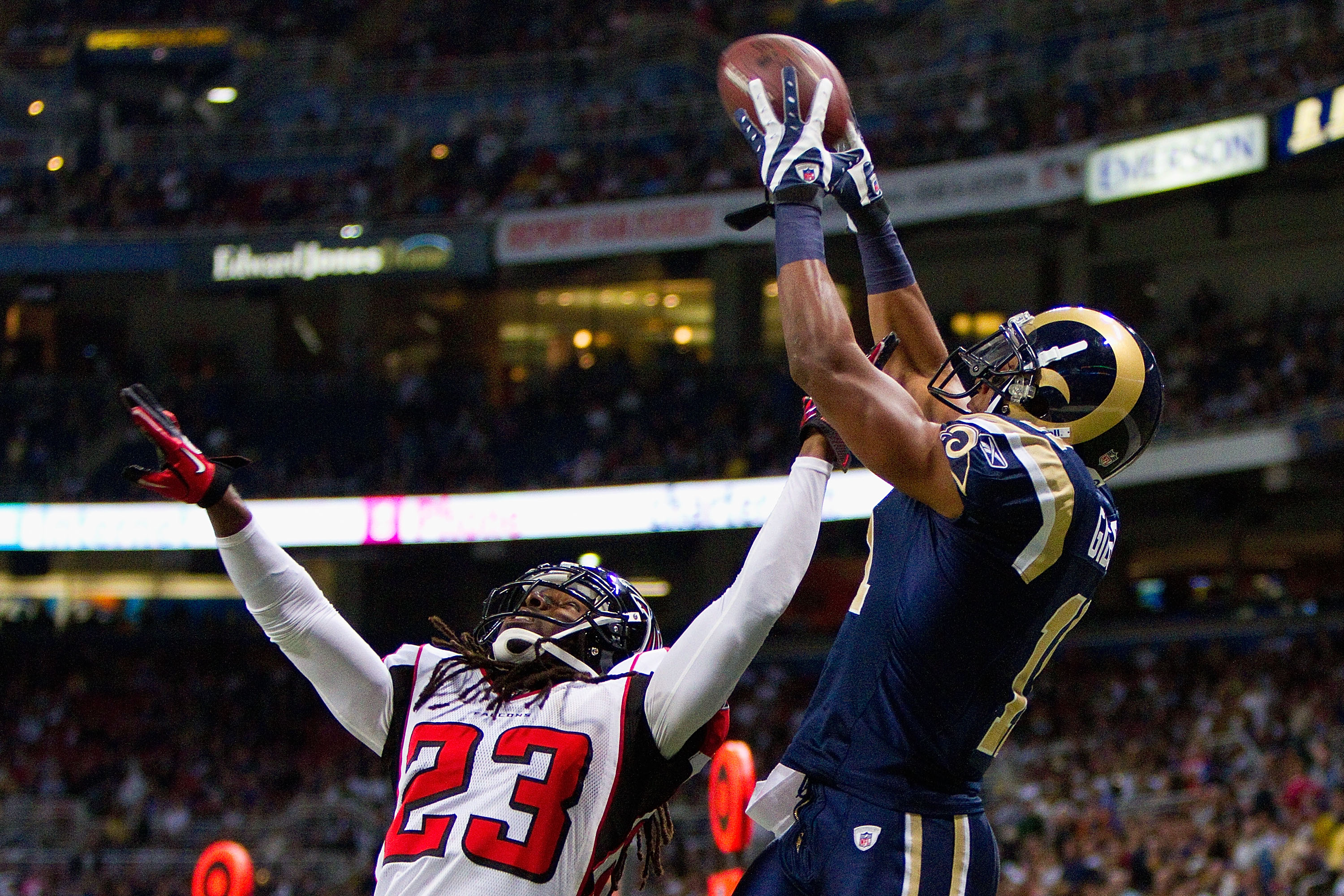 ST. LOUIS - NOVEMBER 21: Brandon Gibson #11 of the St. Louis Rams catches a touchdown pass against Dunta Robinson #23 of the Atlanta Falcons at the Edward Jones Dome on November 21, 2010 in St. Louis, Missouri.  The Falcons beat the Rams 34-17.  (Photo by