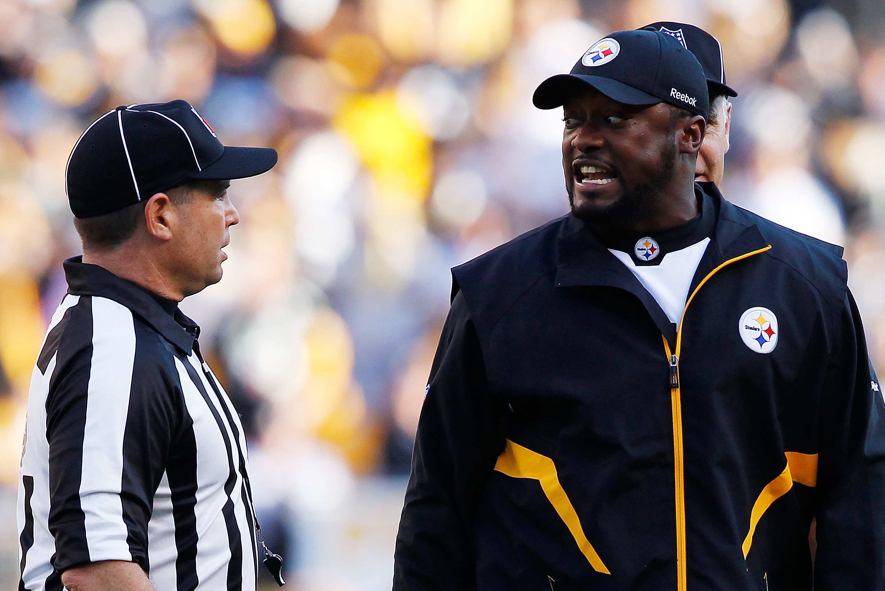 PITTSBURGH - NOVEMBER 21:  Head coach Mike Tomlin of the Pittsburgh Steelers argues with referees after a scrum took place in the middle of the field during the game against the Oakland Raiders on November 21, 2010 at Heinz Field in Pittsburgh, Pennsylvan