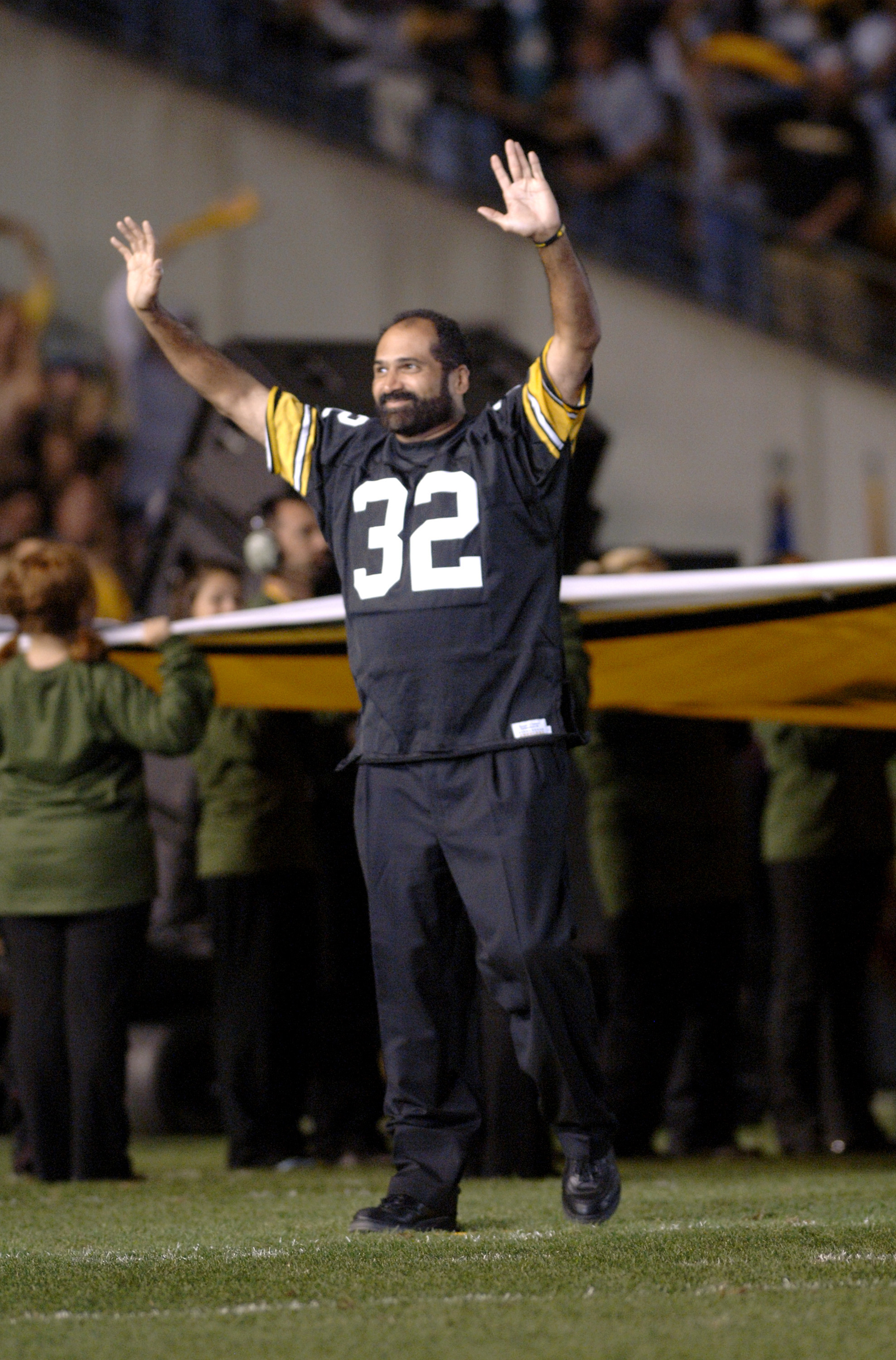 Retired Pittsburgh Steelers running back Franco Harris on the field before the NFL's 2006 opening game against the Miami Dolphins on September 7, 2006 at Heinz Field in Pittsburgh, Pennsylvania.  The Steelers won 28 - 17.  (Photo by Al Messerschmidt/Getty