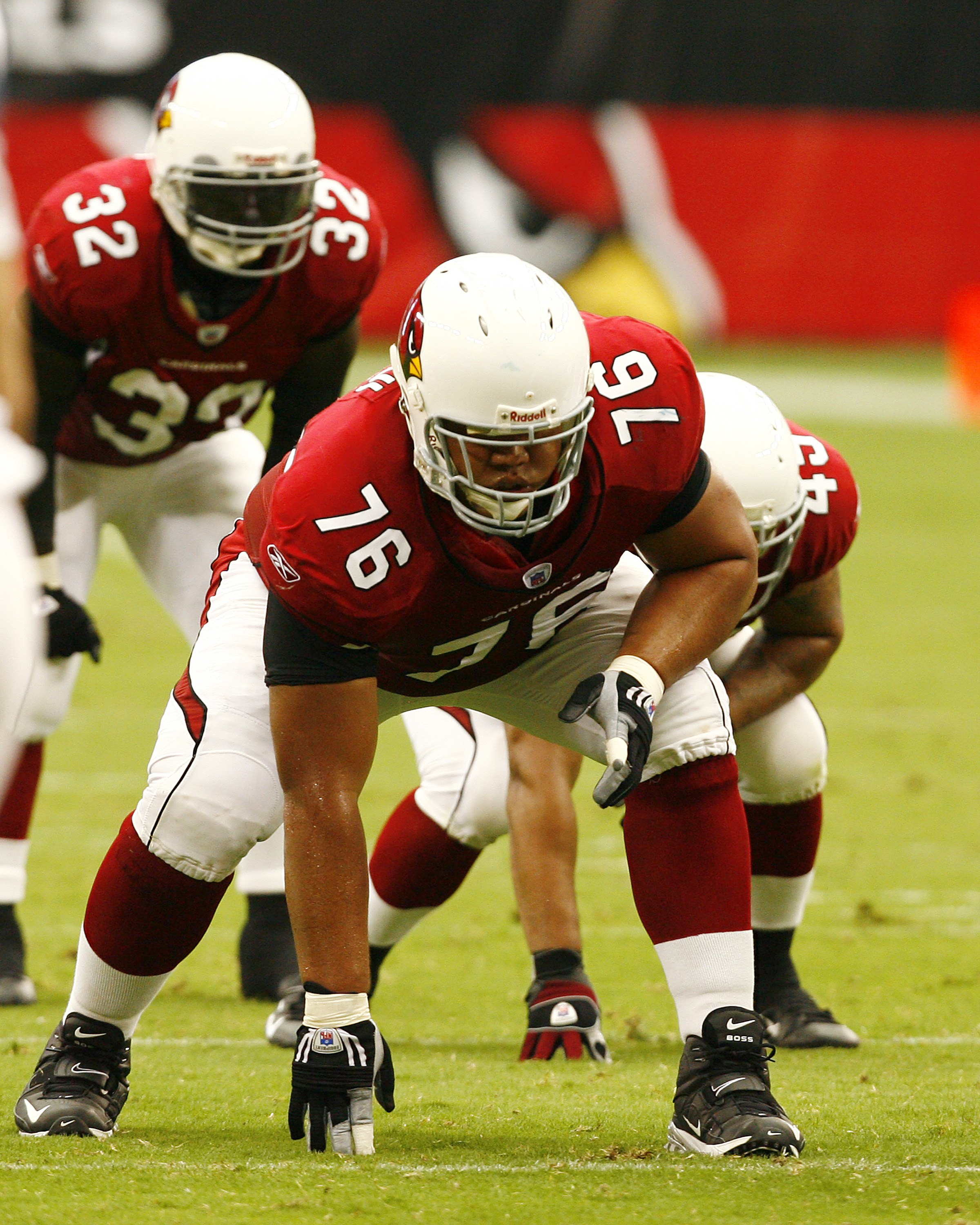 GLENDALE, AZ - SEPTEMBER 16:  Guard Deuce Lutui of the Arizona Cardinals #63 in a three-point stance against the Seattle Seahawks at University of Phoenix Stadium on September 16, 2007 in Glendale, Arizona.  The Cardinals defeated the Seahawks 23-20. (Pho