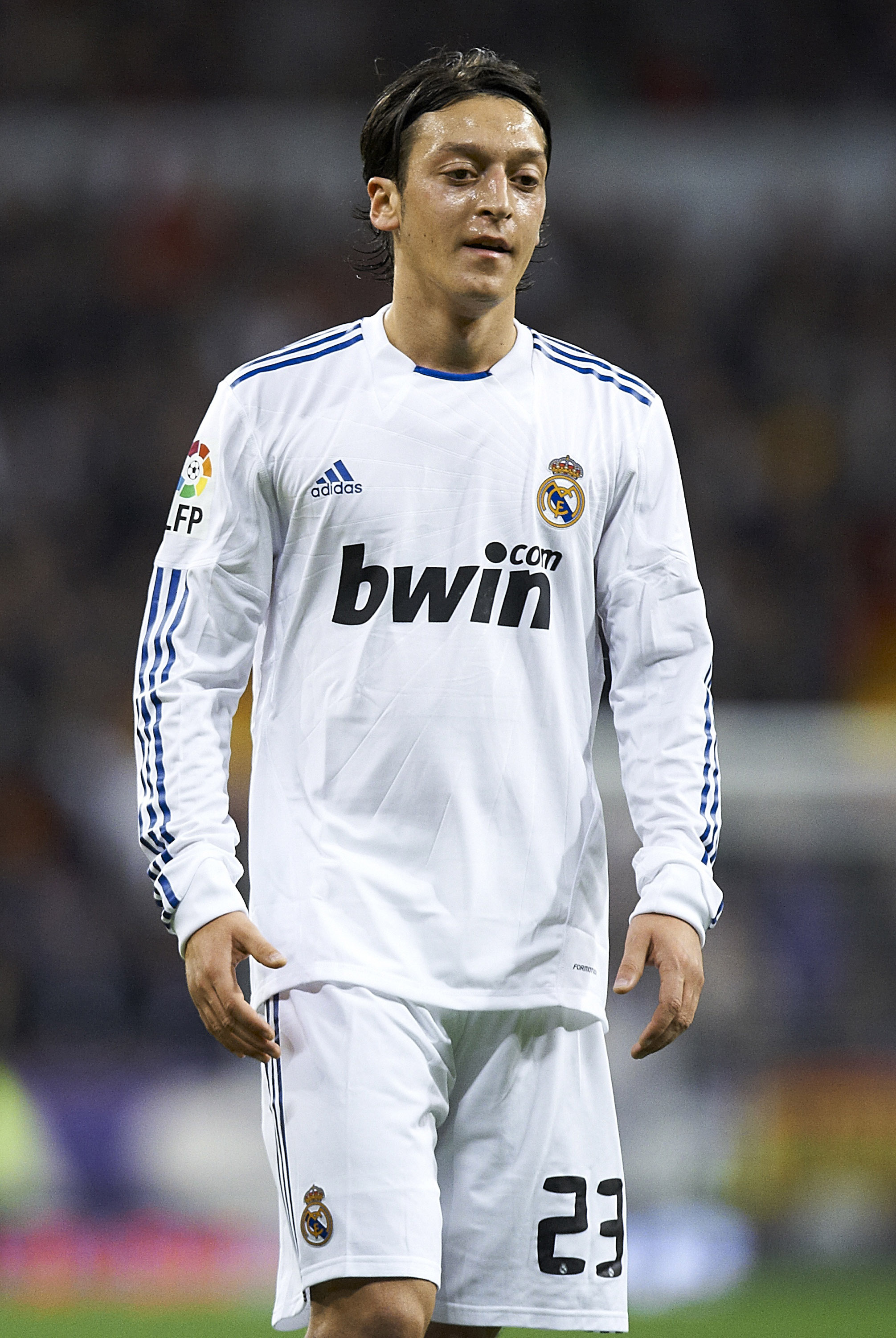 MADRID, SPAIN - NOVEMBER 20:  Mesut Ozil of Real Madrid looks on during the la liga match between Real Madrid and Athletic Bilbao at Estadio Santiago Bernabeu on November 20, 2010 in Madrid, Spain. Real Madrid won 5-1.  (Photo by Manuel Queimadelos Alonso